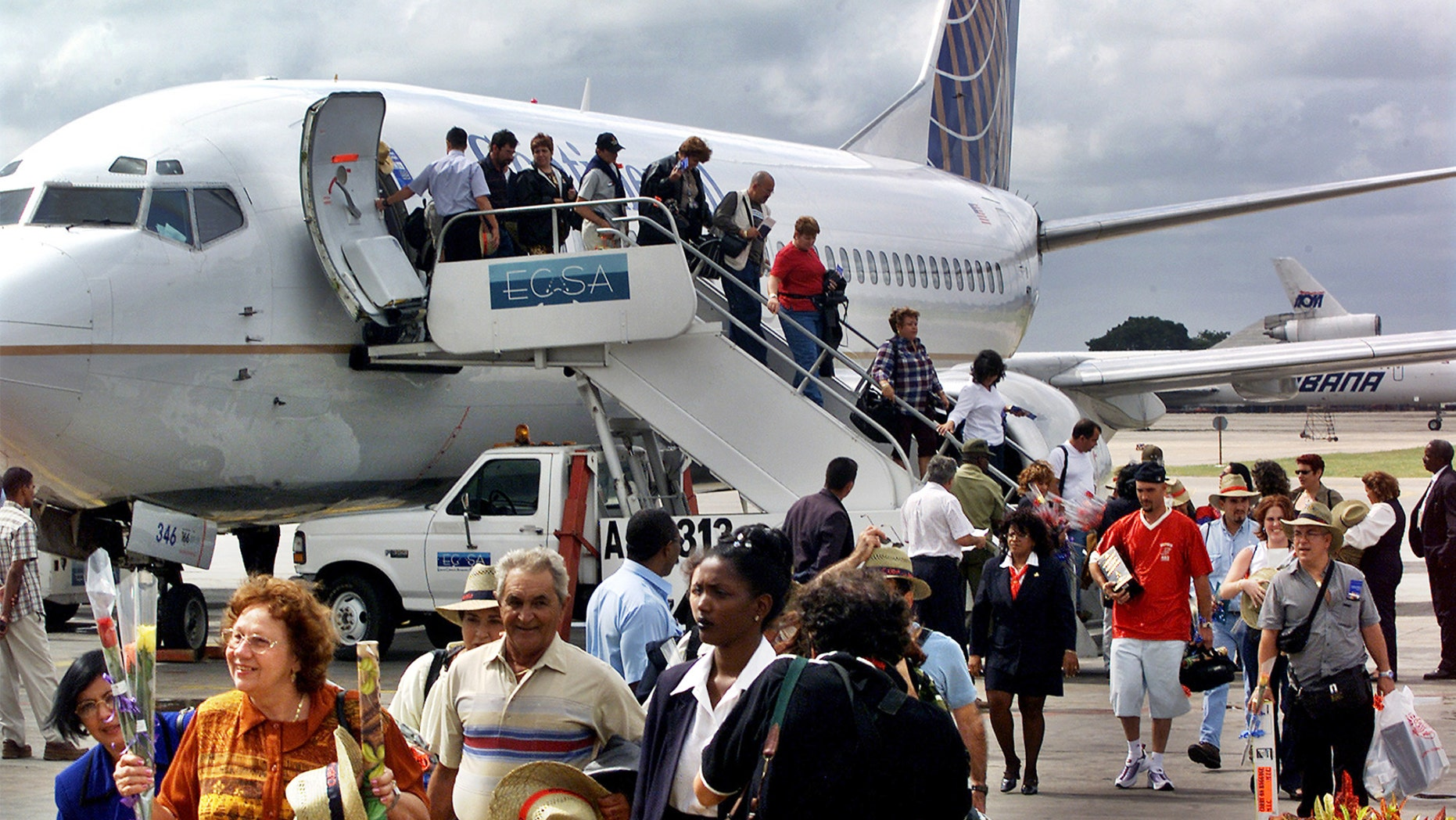 In this Nov. 1, 2001, file photo, the first passengers of the first flight of Continental Airlines from Miami Florida, arrives at the Jose Marti Airport of Havana, Cuba.