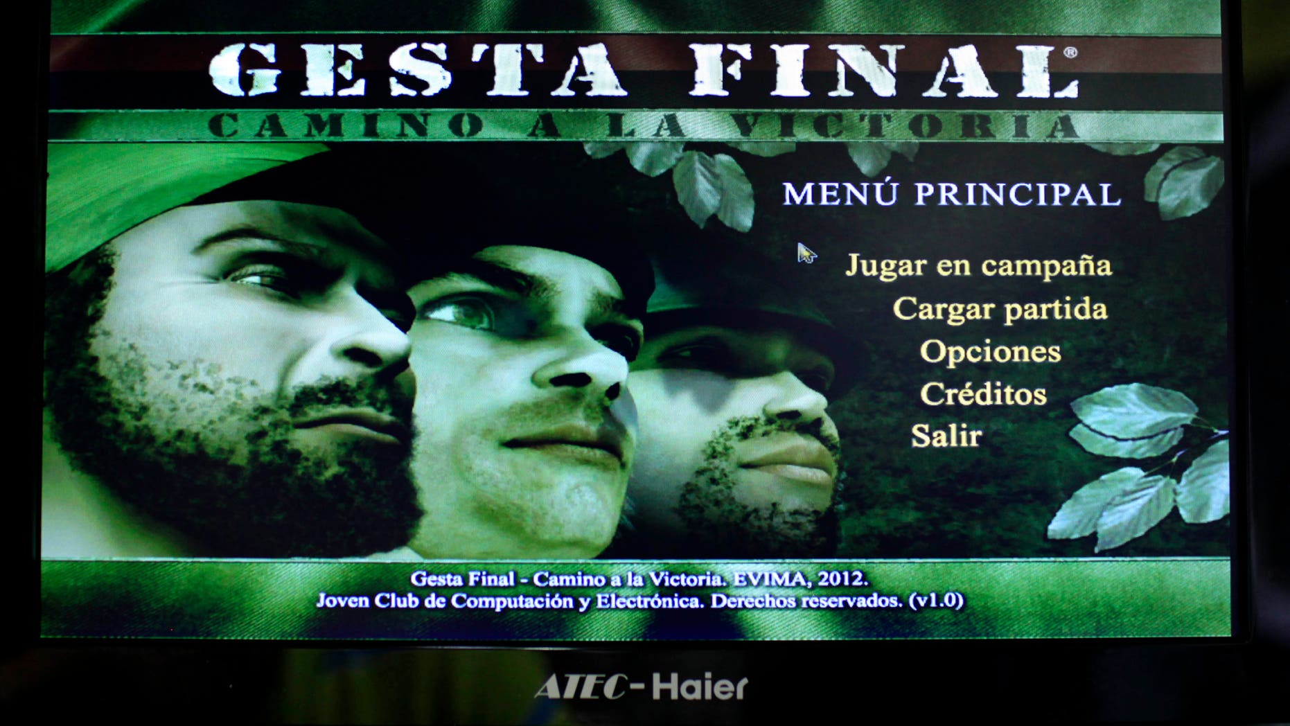 """This March 22, 2013 photo, shows a video screen displaying the menu page for the game """"Gesta Final"""" - which translates roughly as """"Final Heroic Deed,"""" at a technology fair in Havana, Cuba. Island programmers have unveiled the brand new 3-D shoot-'em-up video game that puts a distinctly Cuban twist on gaming, letting players recreate decisive clashes from the 1959 revolution and giving youngsters a taste of the uprising in which many of their grandparents fought.(AP Photo/Franklin Reyes)"""