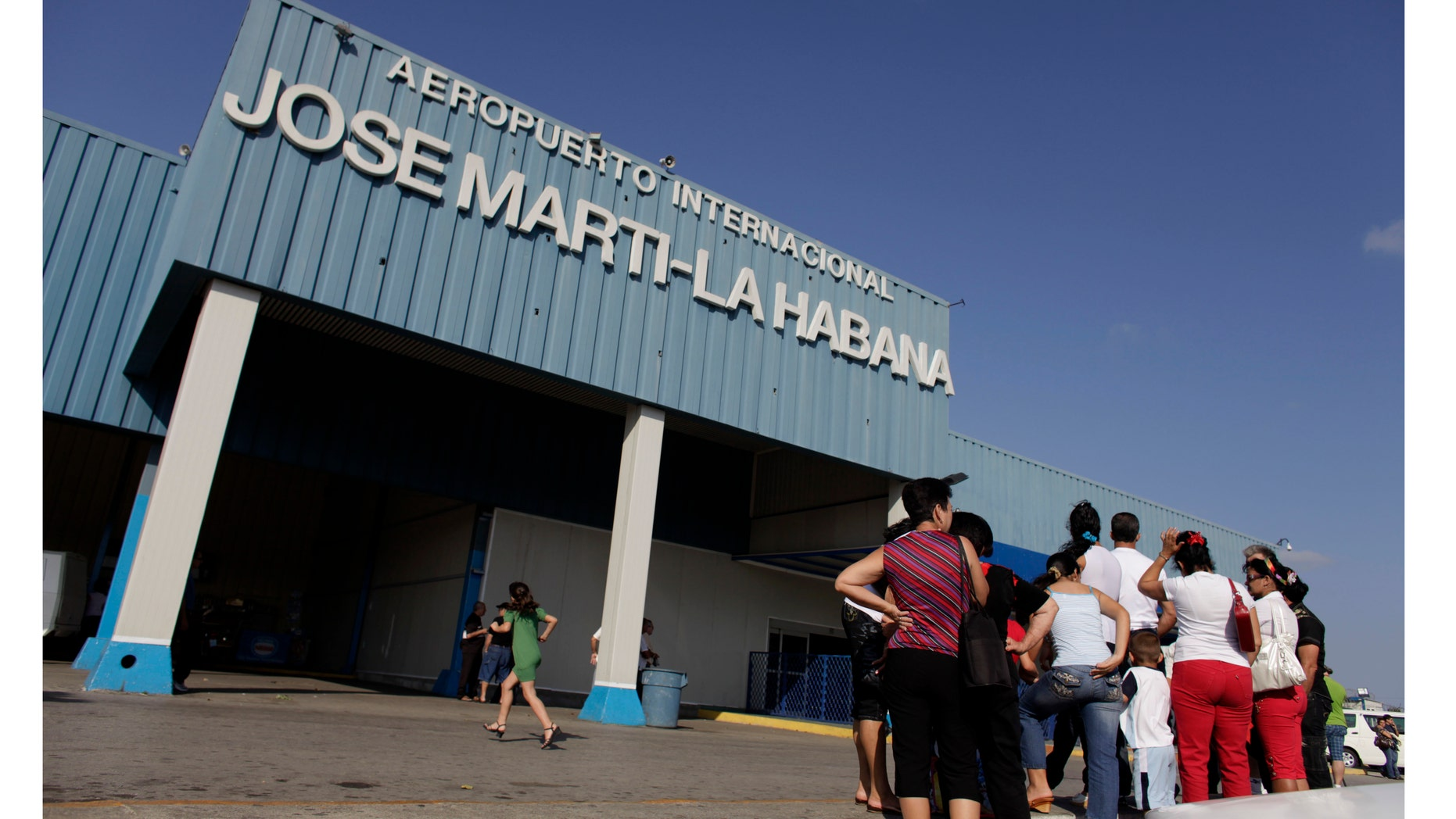 People wait for relatives arriving from the U.S. outside the Jose Marti International Airport in Havana, Cuba. Cuba's government appears on the verge of a momentous decision that could end a half-century of travel restrictions that make it difficult to leave the Communist-run island, even for vacation.