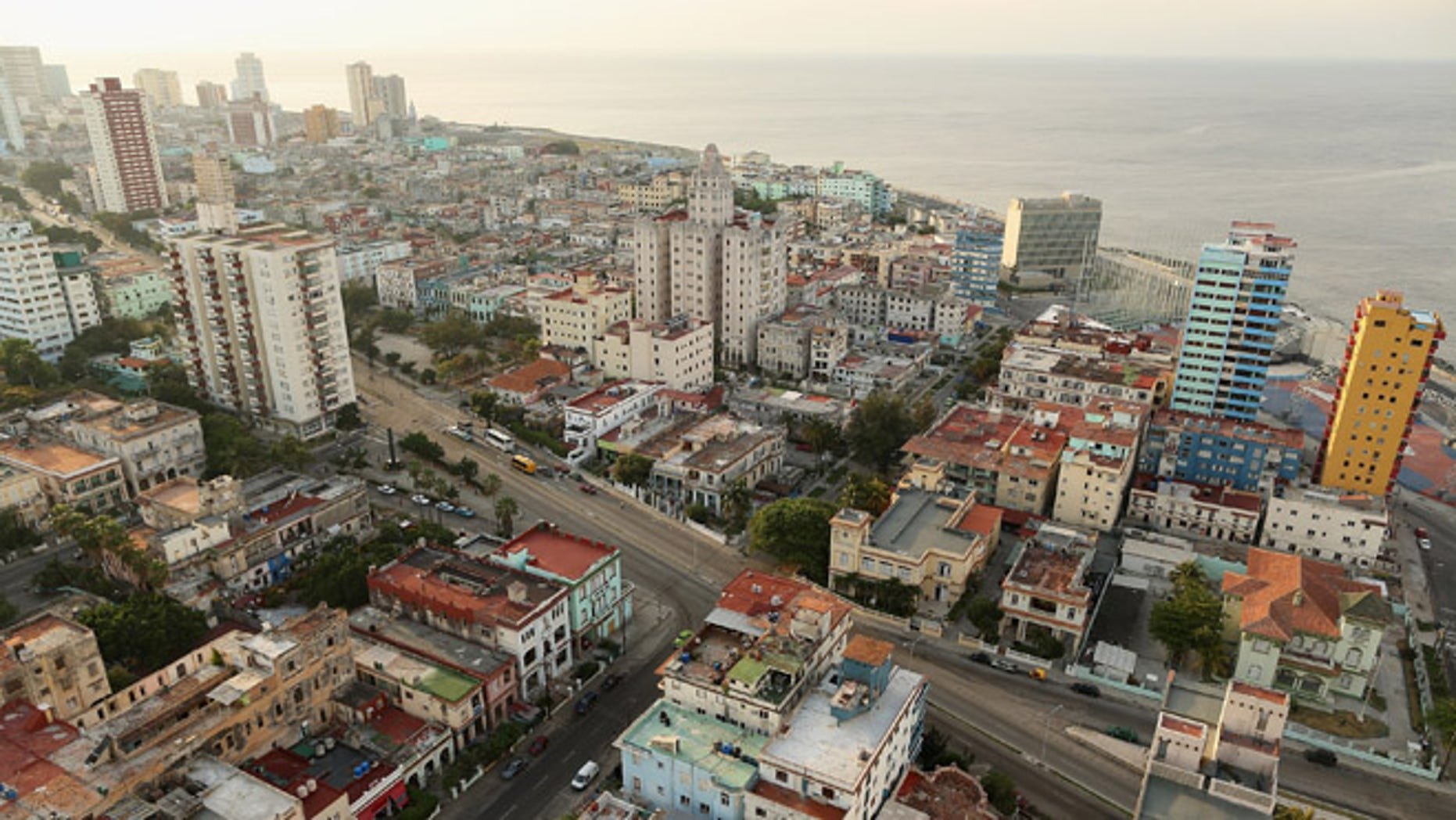 Tightly packed apartment buildings in varying states of repair and disrepair stand in the Vedado neighborhood near the historic Malecón oceanfront drive January 23, 2015 in Havana, Cuba. (Photo by Chip Somodevilla/Getty Images)