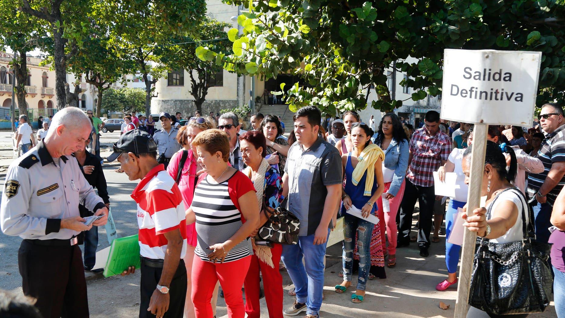People queue for visas at the U.S. Interests Section in Havana, Cuba, Monday, Dec. 22, 2014.