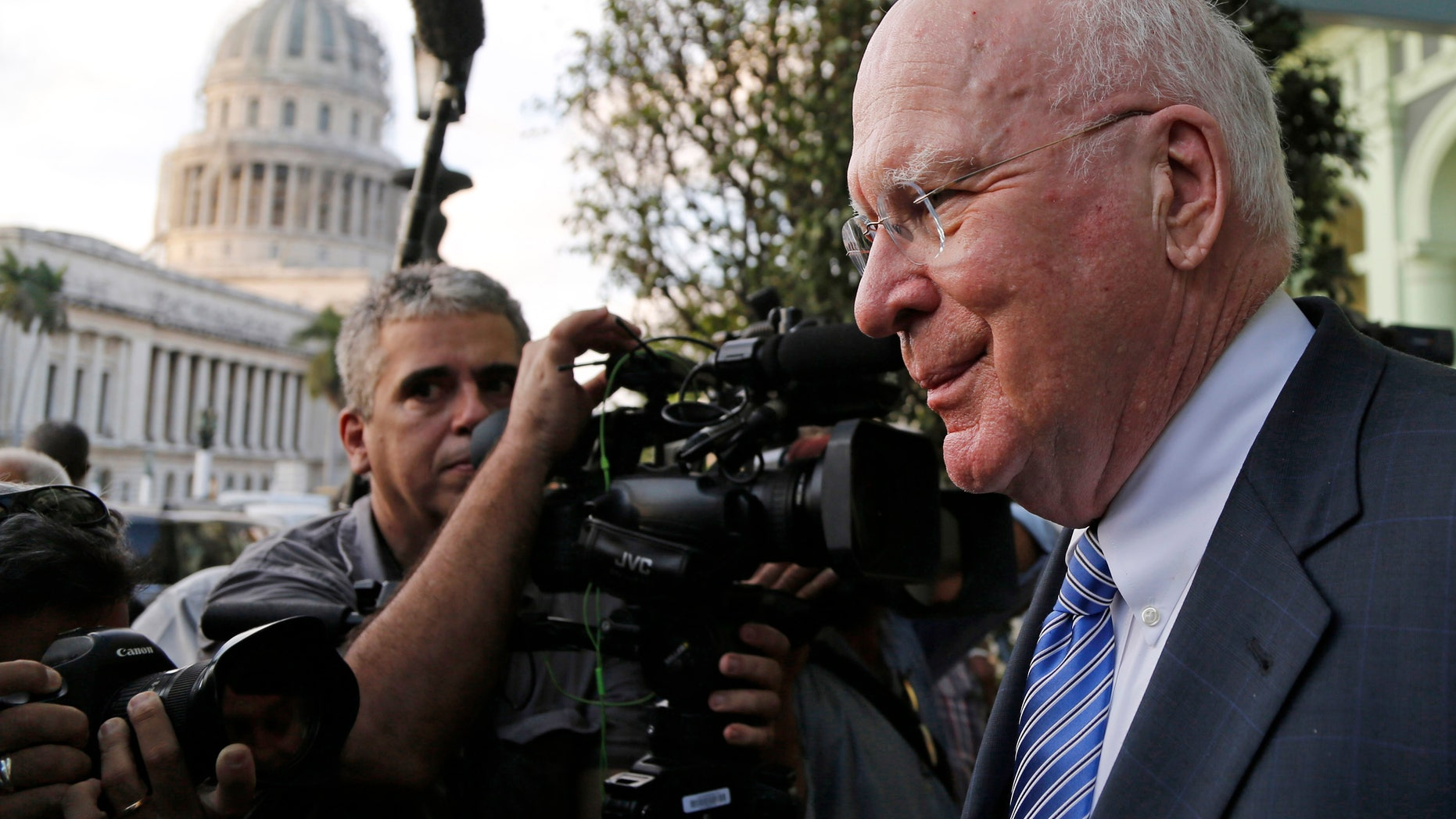 U.S. Senator Patrick Leahy from Vermont leaves after giving a press conference near the capitol building in Havana, Cuba, Monday, Jan. 19, 2015. Leahy, who is heading the first congressional delegation visit to Cuba since President Barack Obama announced in December plans for renewed relations with Cuba, met with Castro on past trips to Cuba but did not do so again on Monday, two days before Assistant Secretary of State Roberta Jacobson arrives in Havana to negotiate the reopening of the U.S. Embassy. (AP Photo/Desmond Boylan)