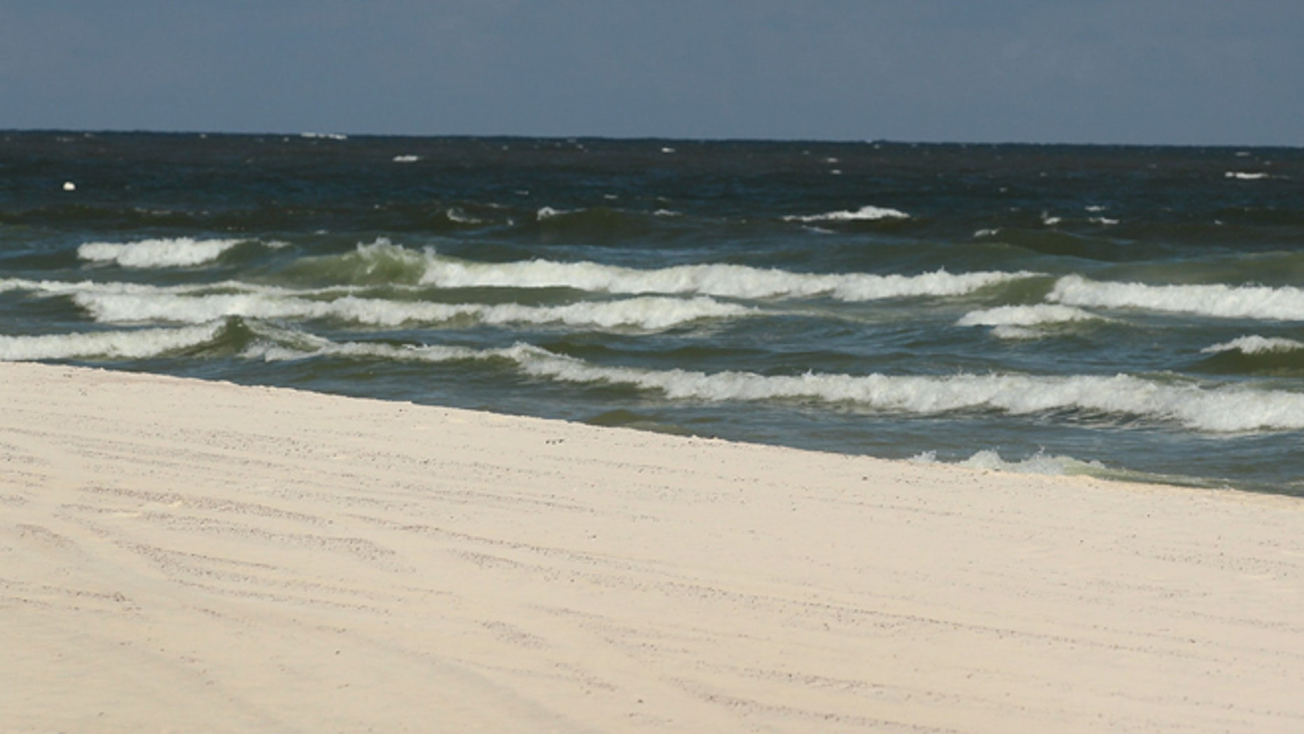 GULF SHORES, AL - JULY 04: Julie Wonder on vacation from Czechoslovakia enjoys an empty beach as people stayed away due to the threat of contamination from the Deepwater Horizon oil spill in the Gulf of Mexico on July 4, 2010 in Gulf Shores,Alabama. The oil spill may have a huge negative economic impact on gulf coast businesses during what should be a busy 4th of July. Millions of gallons of oil have spilled into the Gulf since the April 20 explosion on the drilling platform.  (Photo by Joe Raedle/Getty Images) *** Local Caption *** Julie Wonder
