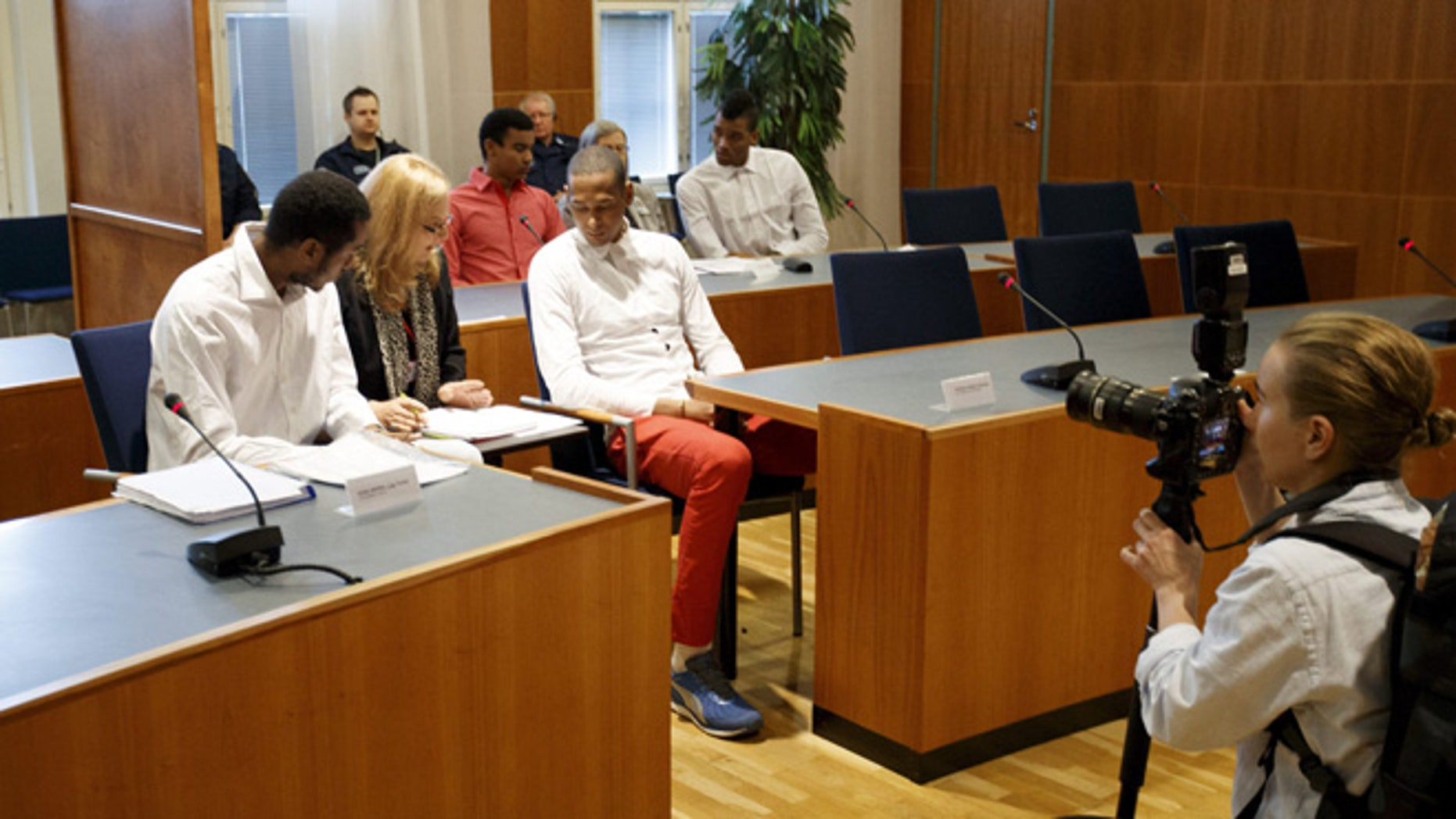 Players of Cuba's national volleyball team accused of rape appear before the court of Tampere, Finland, on August 29, 2016.