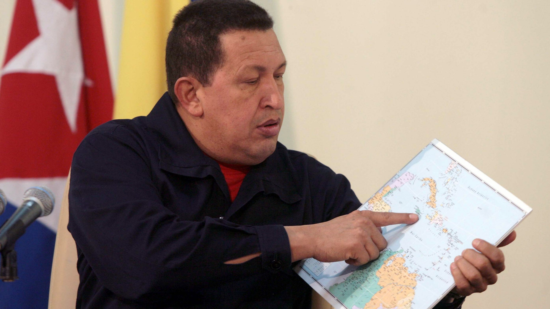 In this photo released by Miraflores Press Office, Venezuela's President Hugo Chavez, left, points at a map of the Caribbean region during a live broadcast interview on Cuban Television, in Havana, Cuba, Sunday Nov. 7, 2010. Chavez is in Cuba to attend meetings between the two governments in the tenth anniversary of their aid and commercial agreements. (AP Photo/Miraflores Press Office, Francisco Batista)