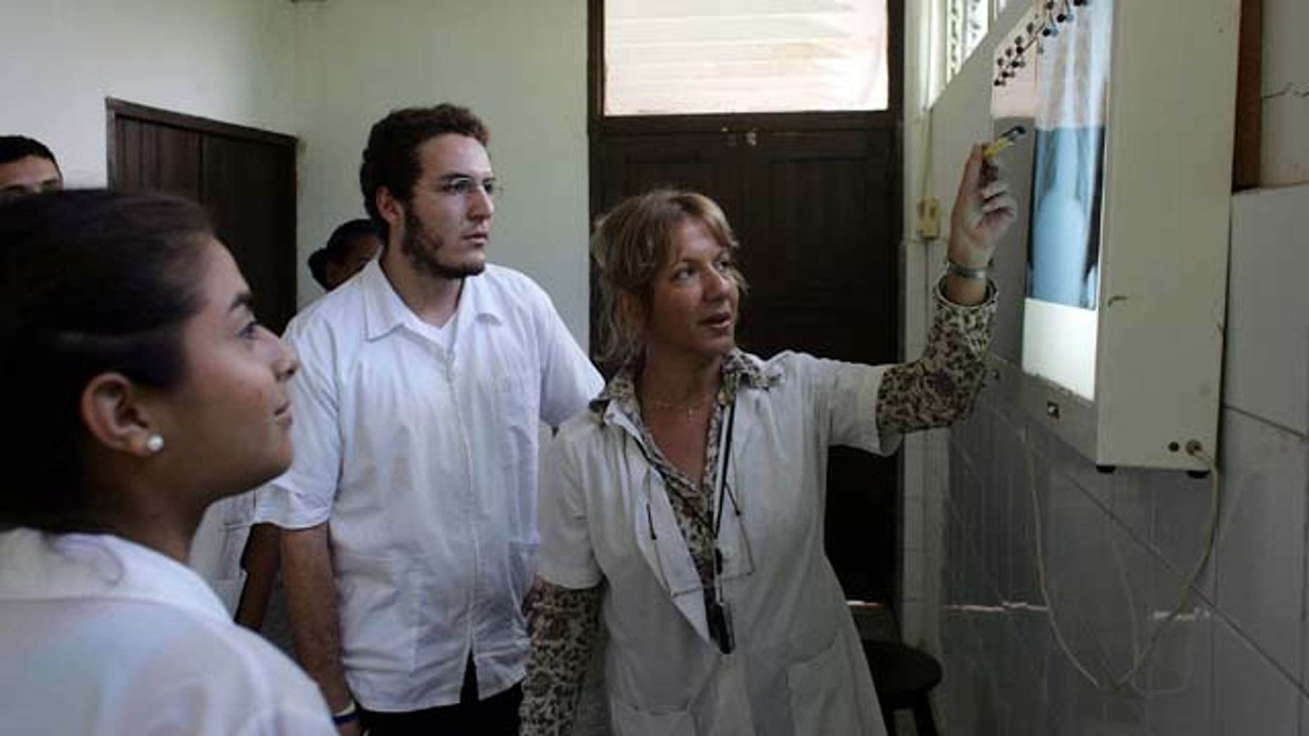 HAVANA - DECEMBER 04: Dr. Nancy Magarita Gonzalez Rodriguez goes over an x-ray with her students at the Latin American School of Medical Sciences December 4, 2006 in Havana, Cuba. Students who graduate from the Caribbean and try to practice in Brazil have overwhelmingly failed a medical exam there, according to Brazil's Ministry of Education.  (Photo by Joe Raedle/Getty Images)