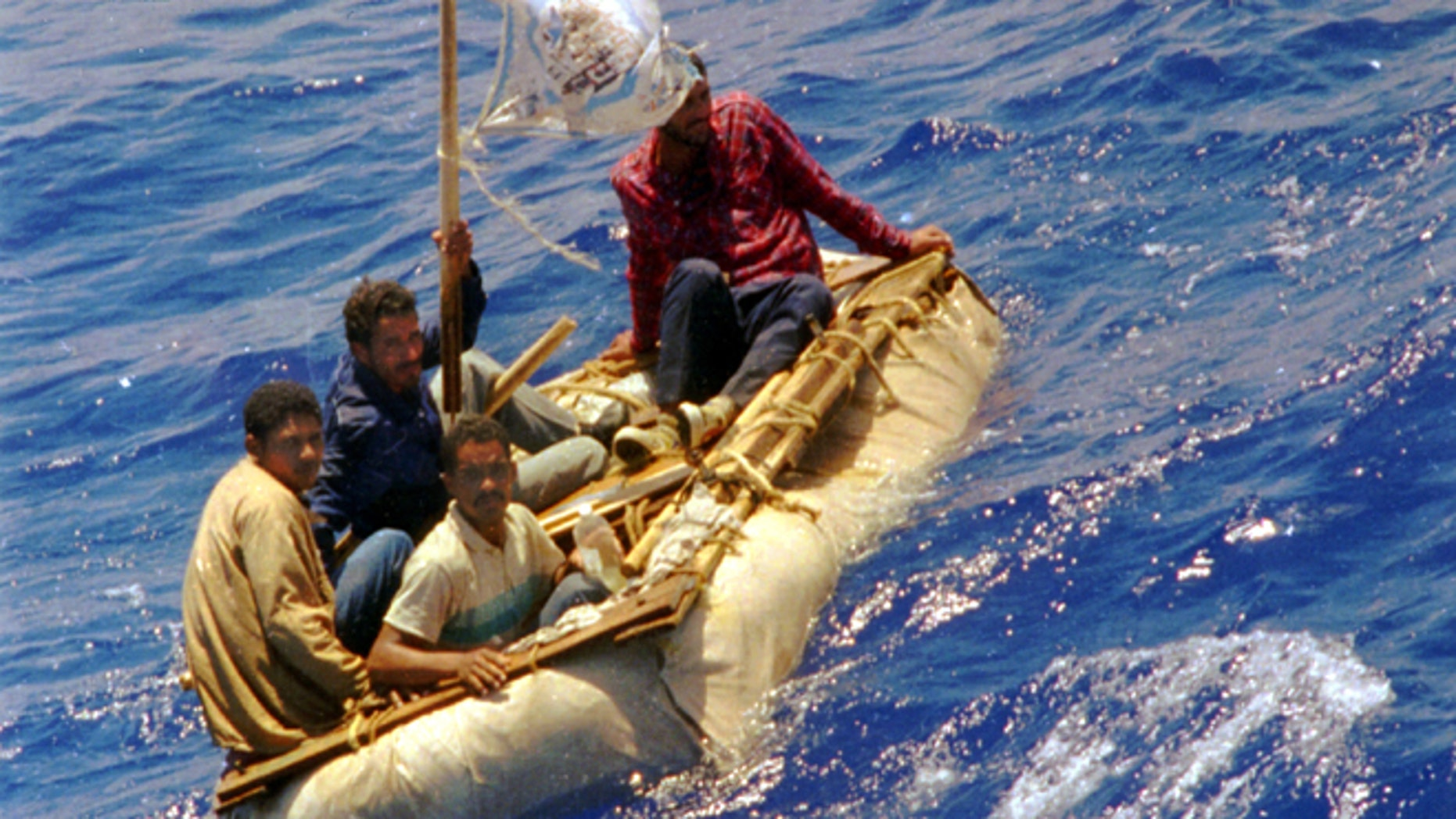 FILE --In this Aug. 26, 1994 file photo, Cuban refugees float in heavy seas 60 miles south of Key West, Fla. In the 20 years since Fidel Castro set off a high-seas humanitarian crisis by encouraging an exodus of 35,000 islanders, more than 26,000 other Cubans have risked their lives crossing the Florida Straits. Already this year, nearly 3,000 have been picked up by U.S. authorities, on a pace to double last years total. Experts say it shows the limits of the wet-foot, dry-foot policy that solved the 1994 crisis. (AP Photo/Dave Martin, File)