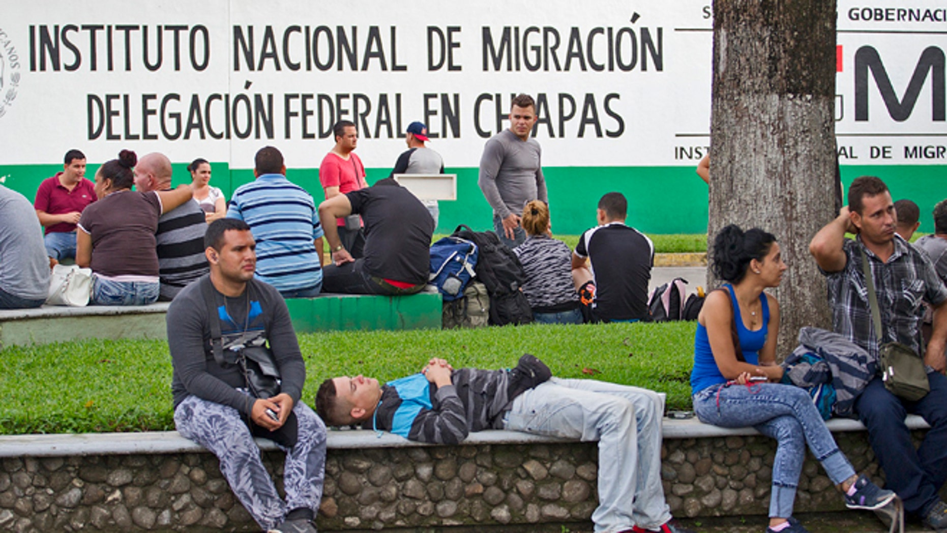 Cuban migrants wait to be processed outside the Mexican National Institute of Migration shortly after they had crossed the Rio Suchate, the body of water that separates Guatemala from Mexico, that is being used by hundreds of Cubans headed to the United States. (Patrick Farrell/Miami Herald/TNS via Getty Images)