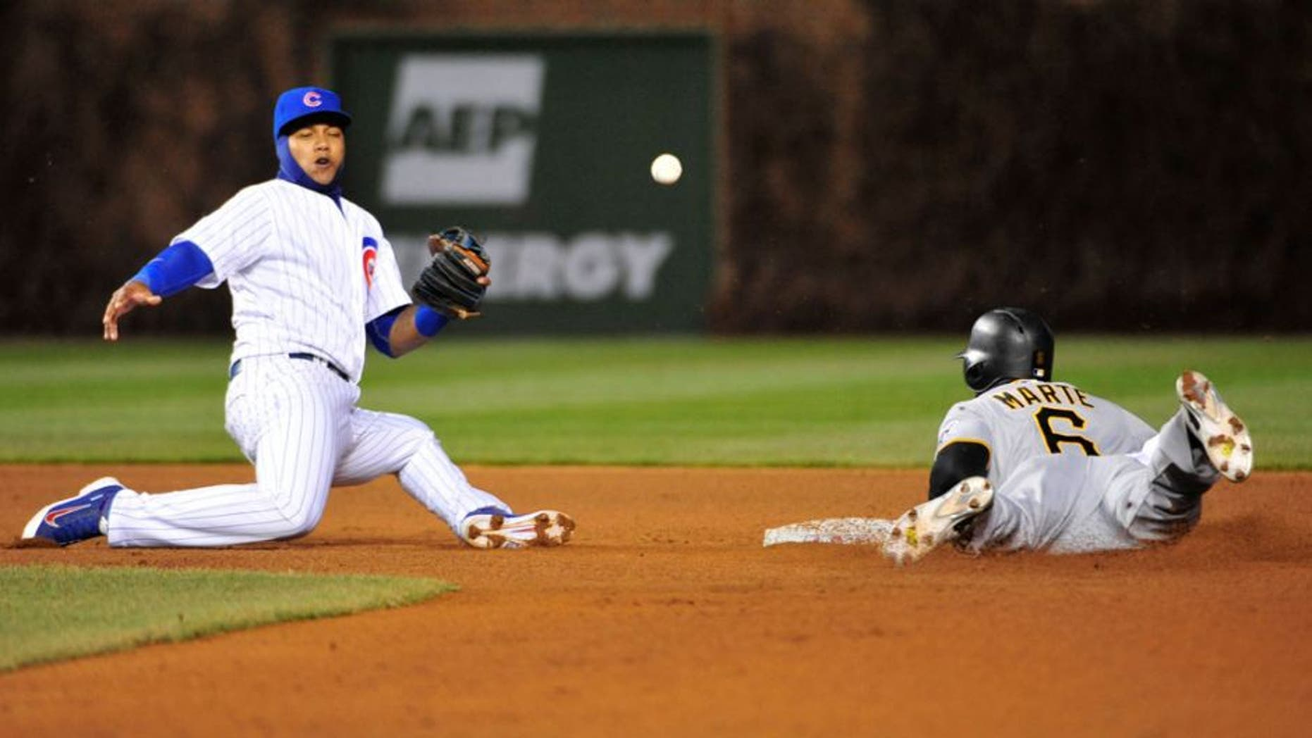 CHICAGO, IL - APRIL 29: Starling Marte #6 of the Pittsburgh Pirates steals second base as Starlin Castro #13 of the Chicago Cubs can't handle the throw during the fourth inning on April 29, 2015 at Wrigley Field in Chicago, Illinois. (Photo by David Banks/Getty Images)