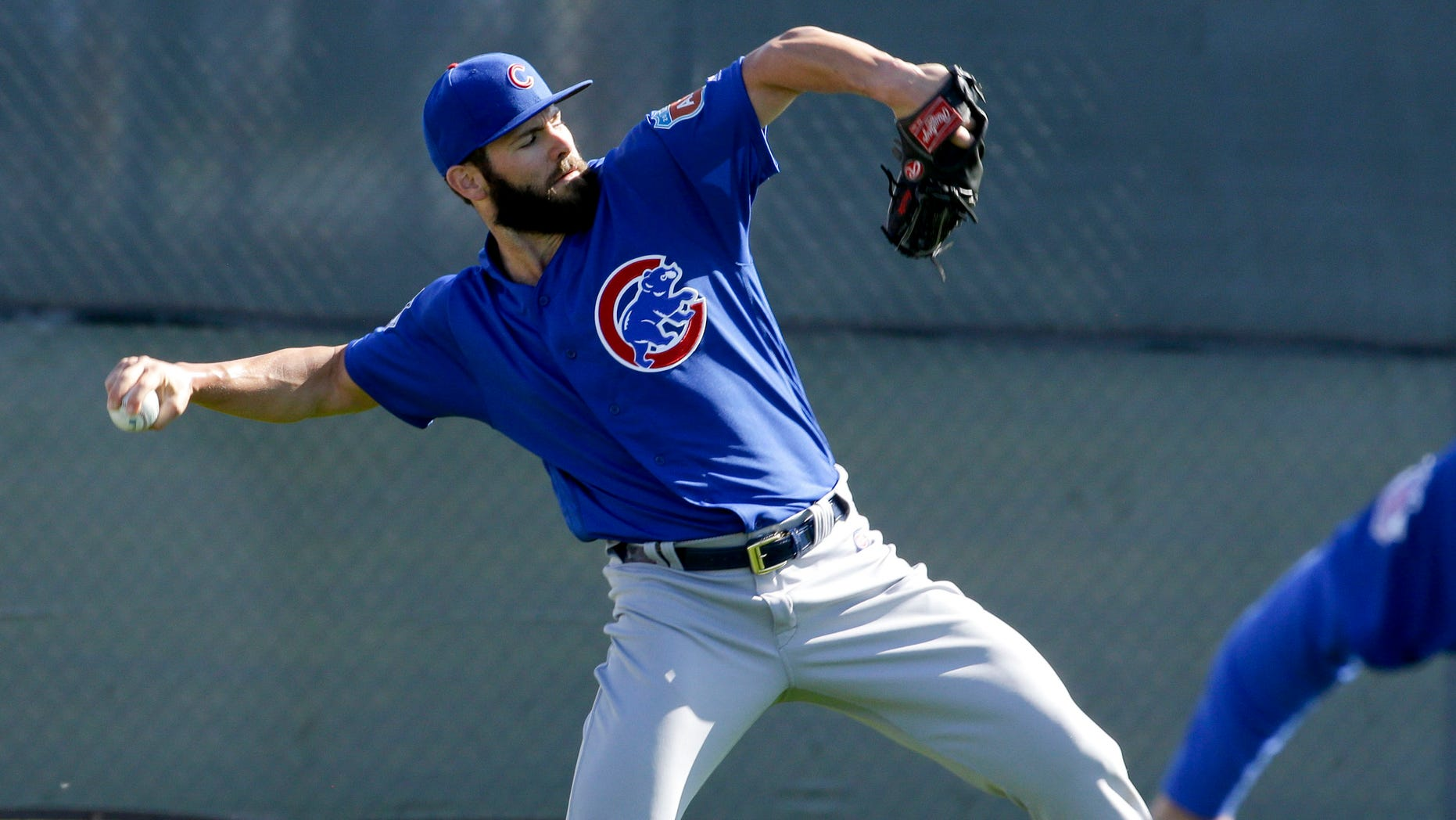 Chicago Cubs starting pitcher Jake Arrieta throws during spring baseball practice in Mesa, Ariz., Saturday, Feb. 20, 2016. (AP Photo/Chris Carlson)