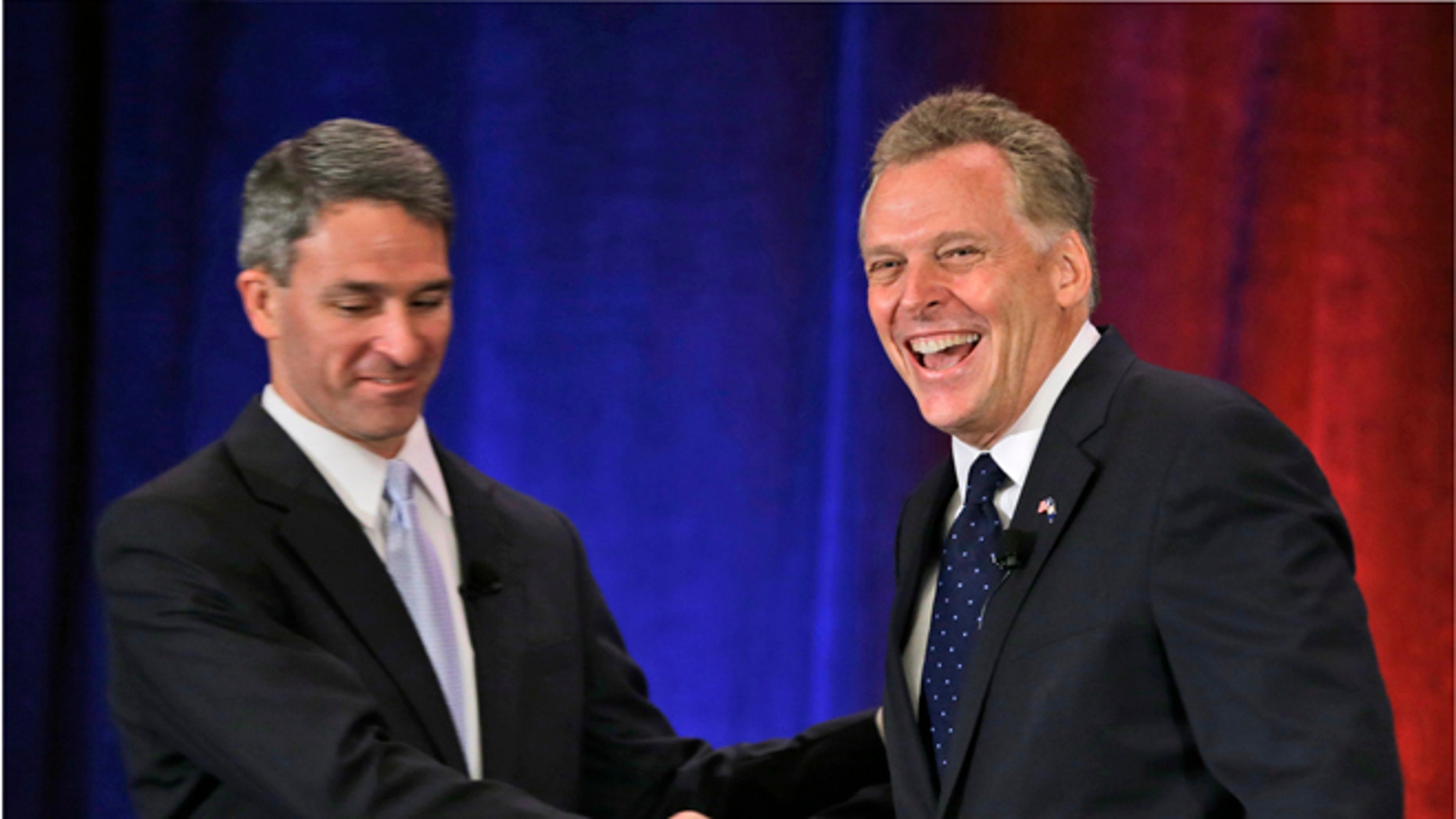 FILE: July 20, 2013: Republican gubernatorial candidate Ken Cuccinelli, left, and Democratic challenger Terry McCauliffe at the Virginia Bar Association convention debate at the Homestead in Hot Springs, Va.
