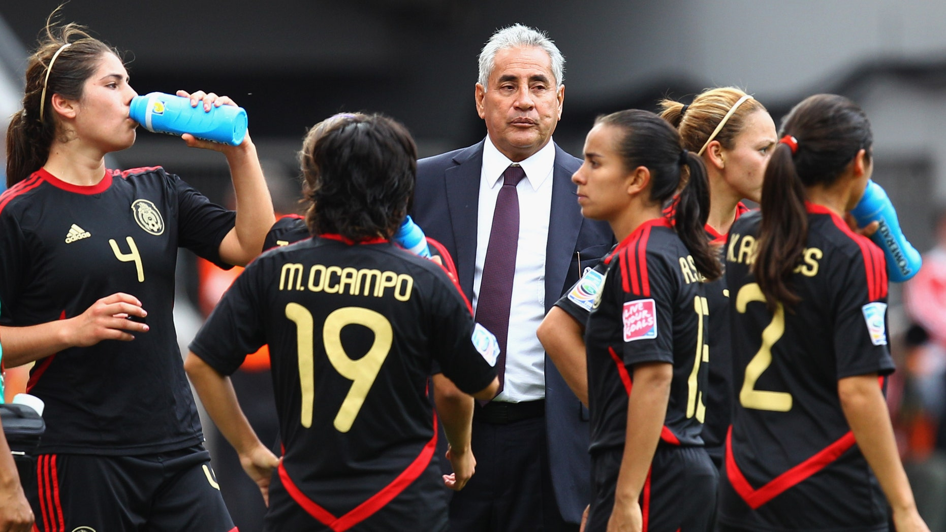 Head coach Leonardo Cuellar of Mexico stands next to his team after the FIFA Women World Cup 2011 Group B match between Japan and Mexico.  (Photo by Alex Grimm/Getty Images)