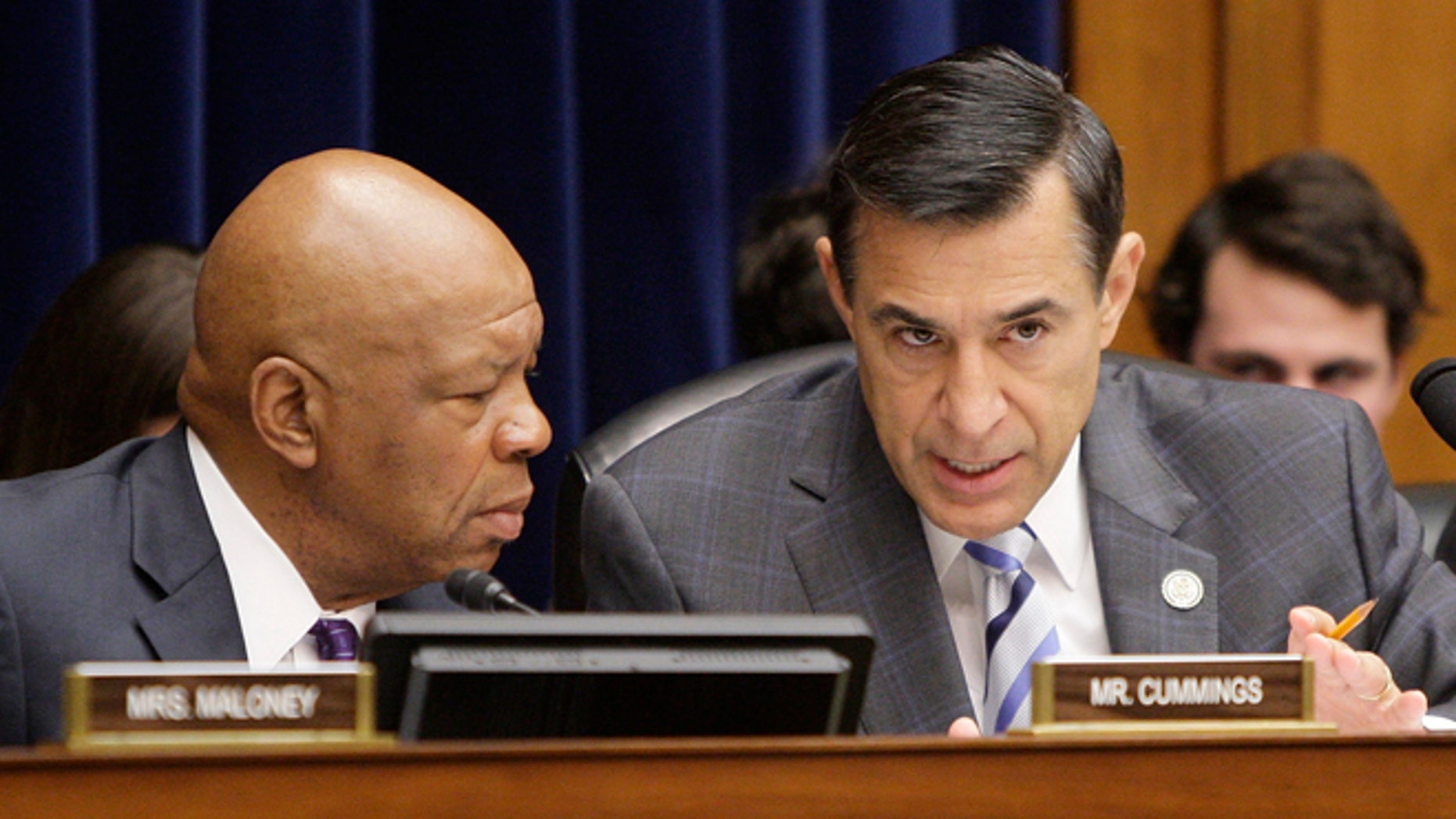 FILE: May 22, 2013: Reps. Elijah Cummings, D-Md., and Darrell Issa, R-Calif., at a House Oversight and Government Reform Committee hearing in Washington, D.C.