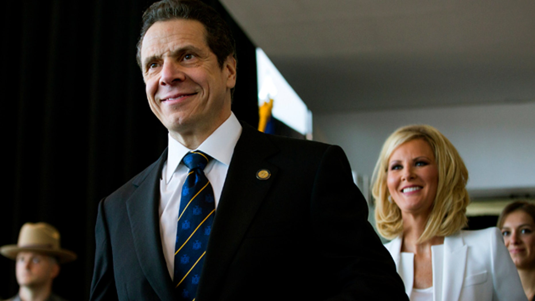 Jan. 1, 2015: New York Gov. Andrew Cuomo arrives for his inaugural ceremony at One World Trade Center in New York. At right is Cuomo's girlfriend Sandra Lee. (AP Photo/Craig Ruttle, Pool)