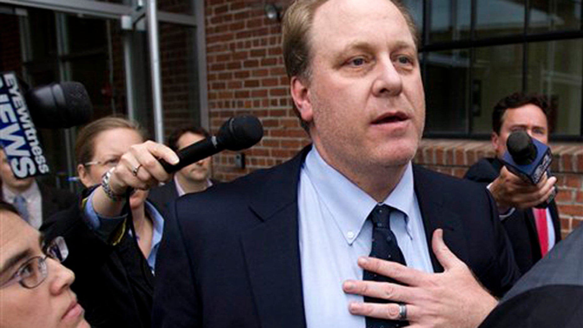 May 16, 2012: Former Boston Red Sox pitcher Curt Schilling, center, is followed by members of the media as he departs the Rhode Island Economic Development Corporation headquarters, in Providence, R.I.