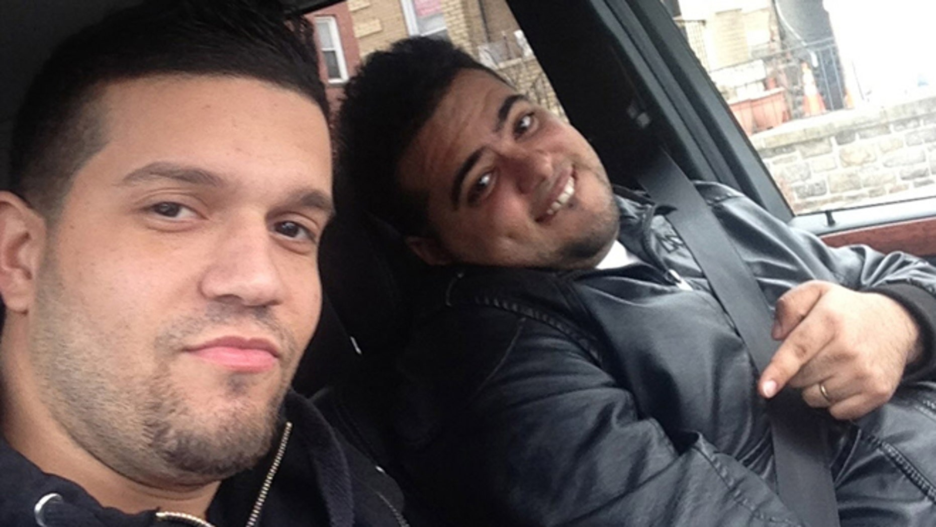In this undated photo provided by the United States Attorneyâs Office for the Southern District of New York, Elvis Rafael Rodriguez, left, and Emir Yasser Yeje, pose with bundles of cash allegedly stolen using bogus magnetic swipe cards at cash machines throughout New York. (AP Photos/U.S. Attorneyâs Office for the Southern District of New York)