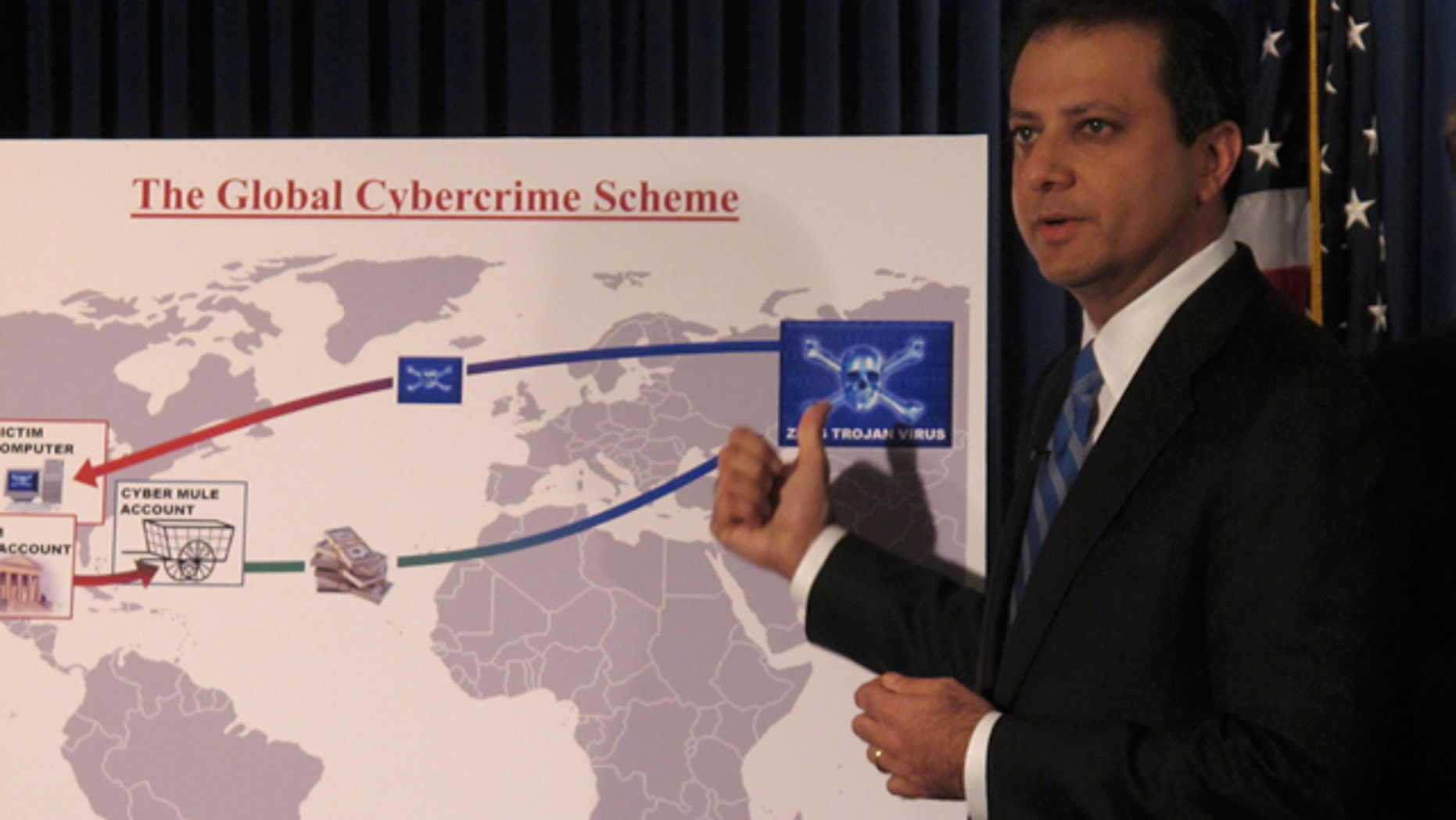 Preet Bharara, U.S. Attorney for the Southern District of New York, explains a Global Cybercrime chart at a press conference announcing dozens of charges against an international group of cybercrimnials.