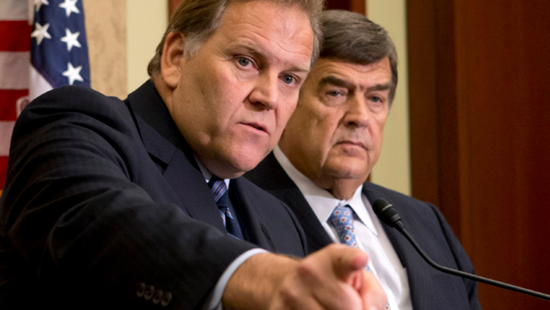 House Intelligence Committee Chairman Rep. Mike Rogers, R-Mich., left, and the committee's ranking Democrat, Rep. C.A. Dutch Ruppersberger, D-Md., participate in a news conference on Capitol Hill in Washington.