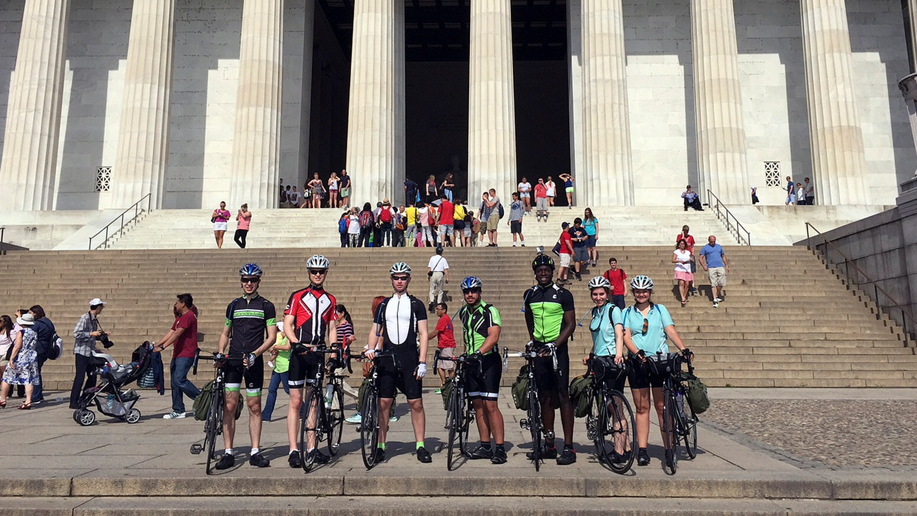 In this June 1, 2015 photo provided by Drew Bent, seven students from Harvard and MIT pose with their bicycles at the Lincoln Memorial in Washington. The seven are participating in a project called Spokes and are cycling across America, stopping in many rural towns to get students interested in science through hands-on workshops. (Courtesy of Drew Bent via AP)