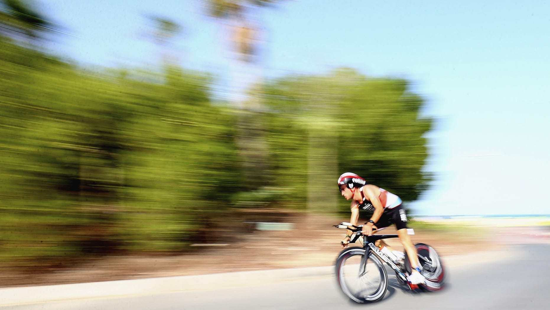 DUBAI, UNITED ARAB EMIRATES - NOVEMBER 07:  Participants compete in the cycle leg of the race during the Dubai International Triathlon at Atlantis, The Palm on November 7, 2014 in Dubai, United Arab Emirates.  (Photo by Francois Nel/Getty Images)