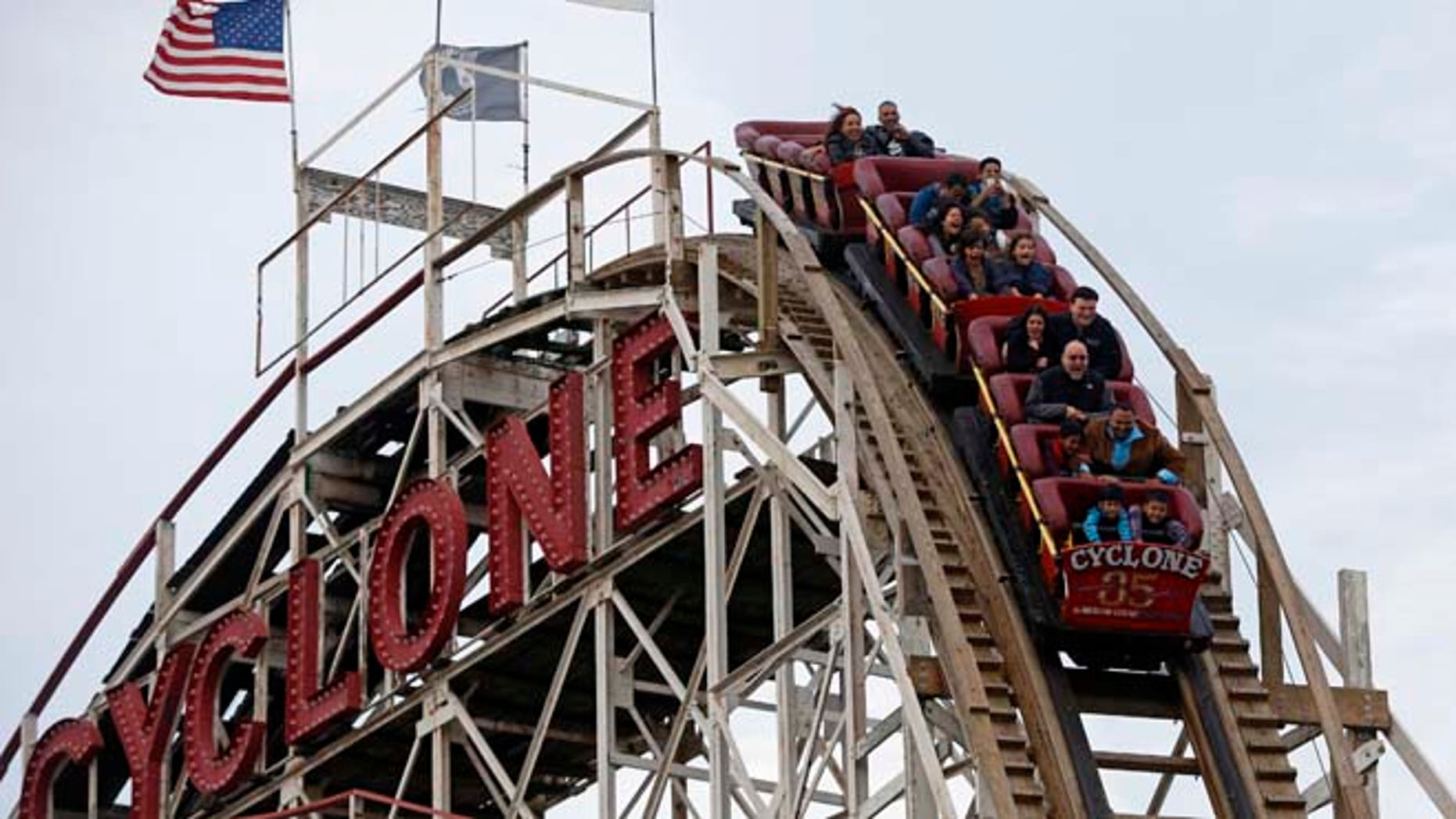 """Oct. 27, 2012: People ride the famous wooden roller coaster """"Cyclone"""", at Coney Island, New York."""