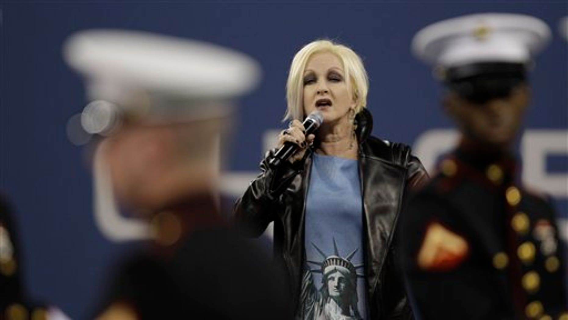 Sept. 10: Cyndi Lauper, center, performs during a ceremony to honor the victims of the Sept. 11 attacks at the U.S. Open tennis tournament in New York. (AP)