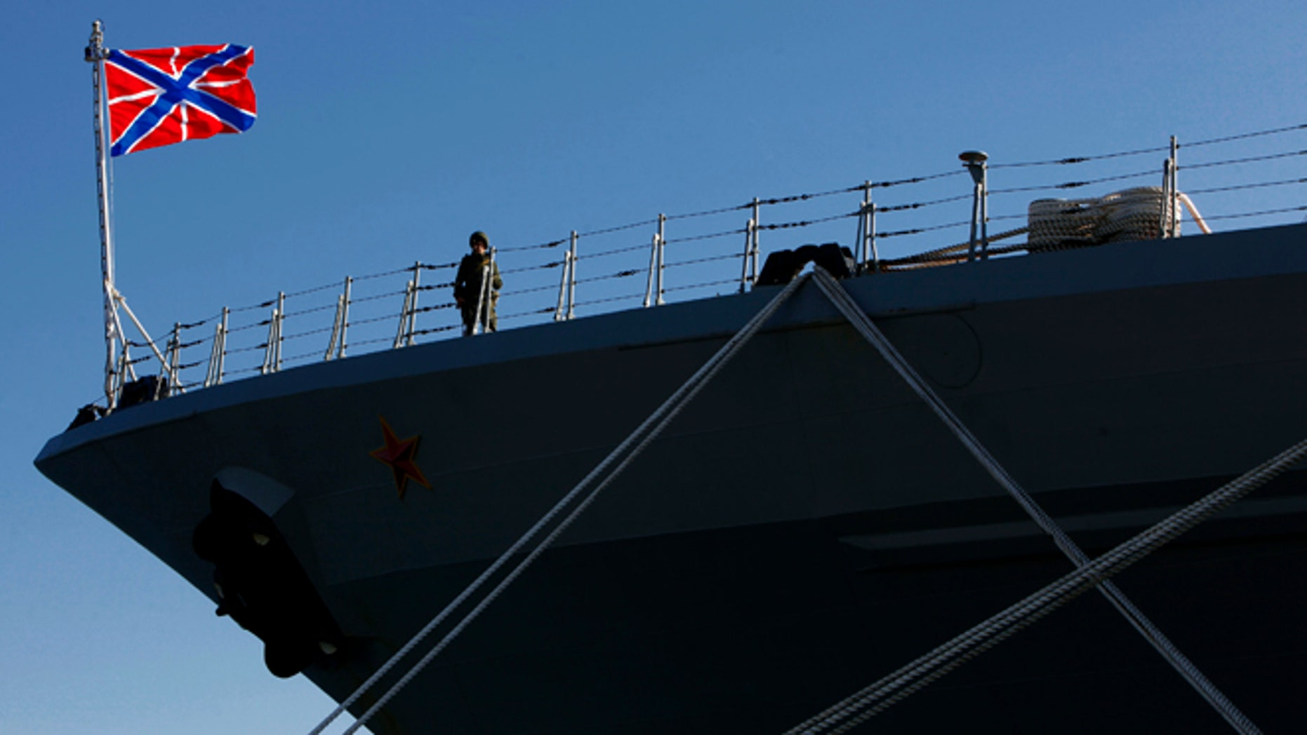 "A Russian sailor stands guard on the Russian war ship ""Peter the Great"" in southern port city of Limassol, Cyprus, on Wednesday, Feb. 12, 2014. The Russian missile cruiser ""Peter the Great"" which is currently deployed in the region made a port of call at Cyprus' largest port. (AP Photo/Petros Karadjias)"