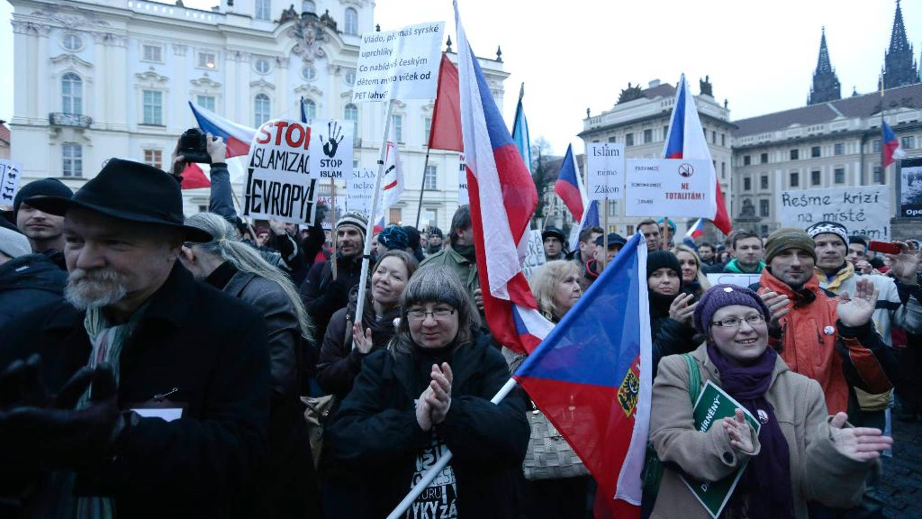 Hundreds of people gather during an anti-Islam rally in Prague, Czech Republic, Friday, Jan. 16, 2015. The gathering came as French and German authorities arrested at least 12 people Friday suspected of links to the Islamic State group and a Paris train station was evacuated, with Europe on alert for new potential terrorist attacks. (AP Photo/Petr David Josek)