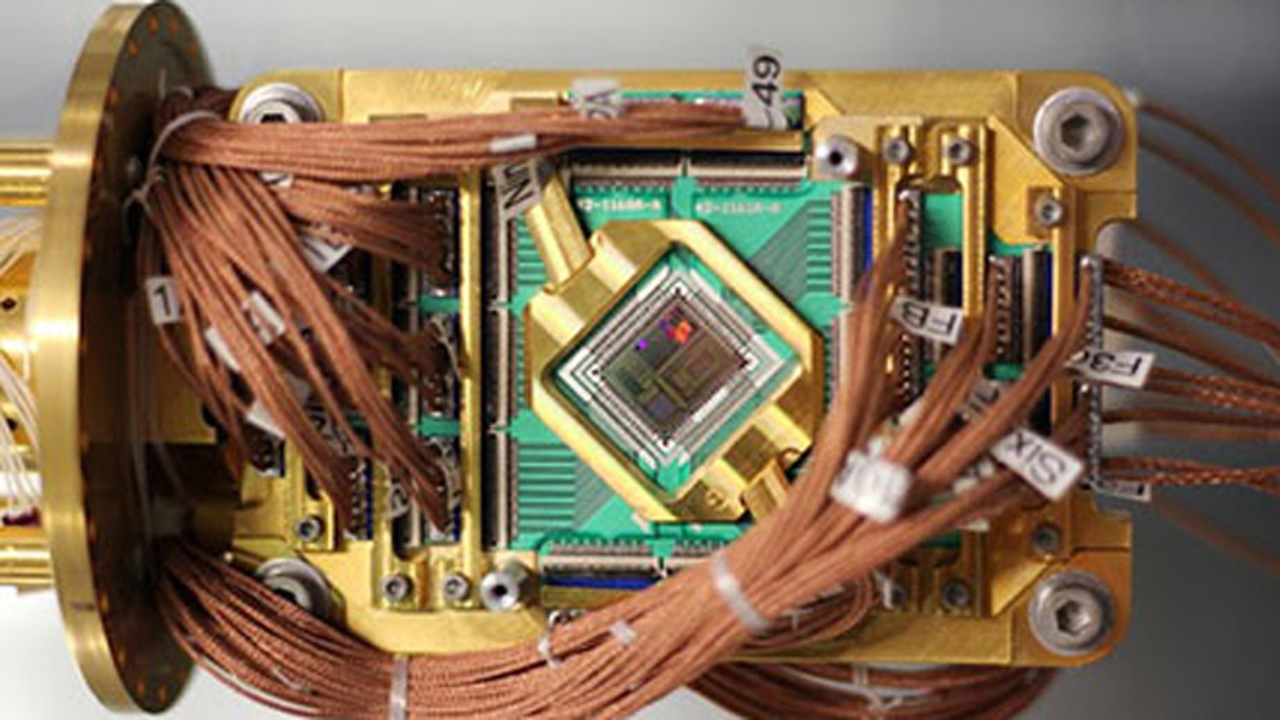 An experimental computer made by a Canadian company has proved its ability to solve increasingly complex mathematical problems. But is it quantum mechanics?