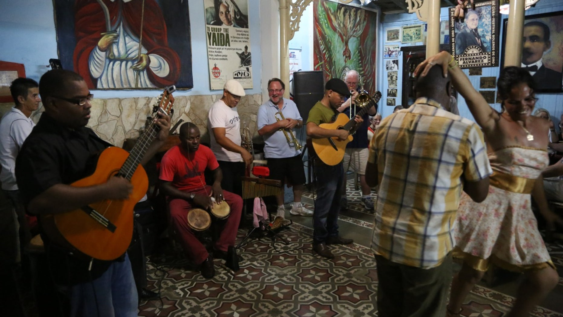 Dr. Mike Davison (light blue shirt) plays his trumpet alongside Cuban musicians at Casa de las Tradiciones, a club in Santiago de Cuba. (Photo by Brian Ross)
