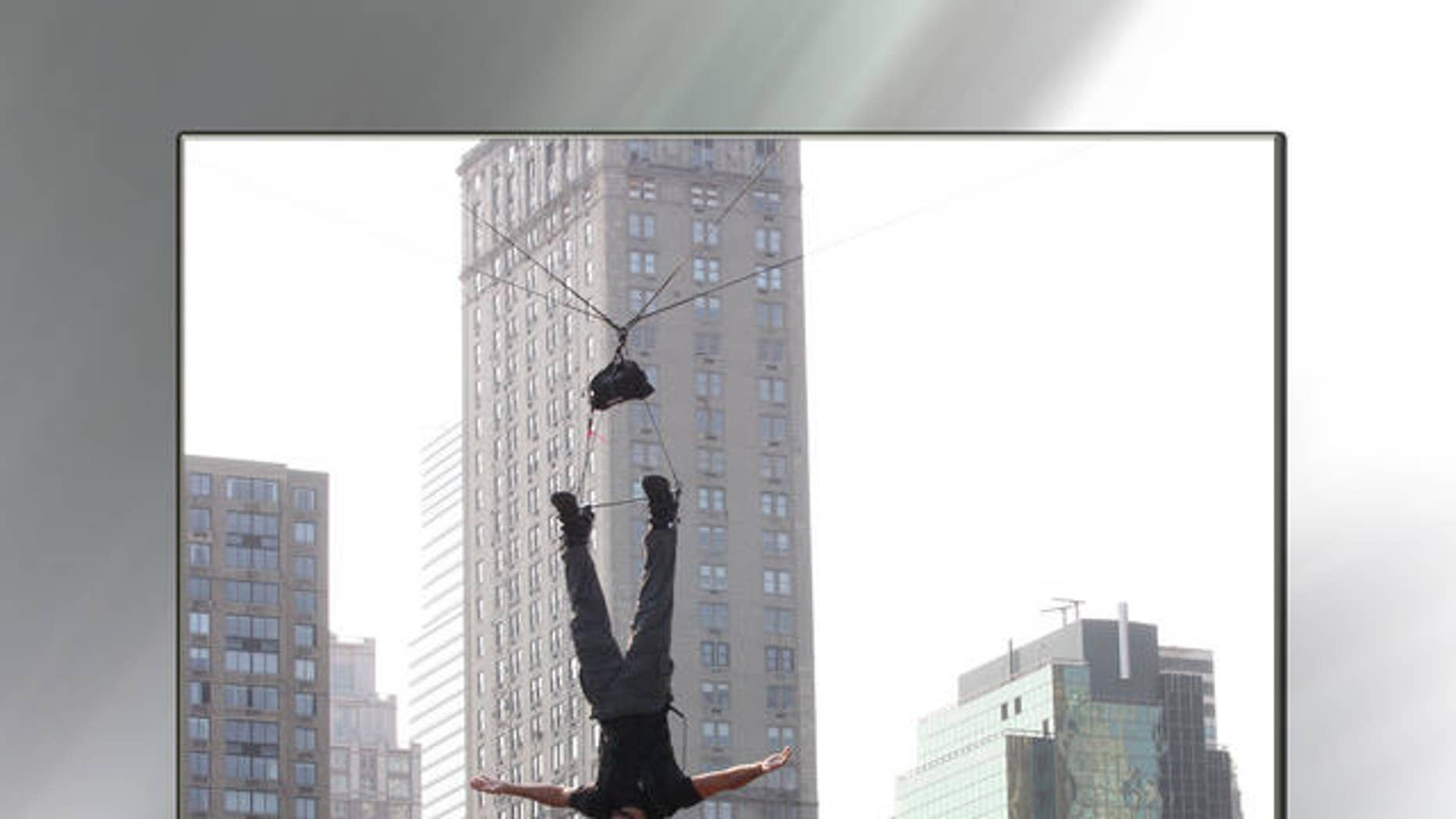 September 22, 2008 - FILE photo of David Blaine stunt hanging over Wollman Rink in New York's Central Park.