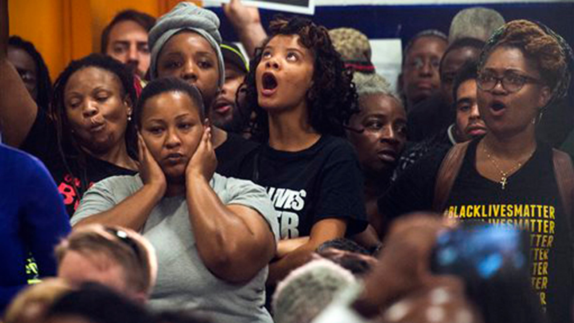 Aug. 27, 2015: People react as Washington D.C. Mayor Muriel Bowser addresses the rise in violent crime in DC during a news conference at the former Malcolm X Elementary School in Congress Heights in Washington, D.C.