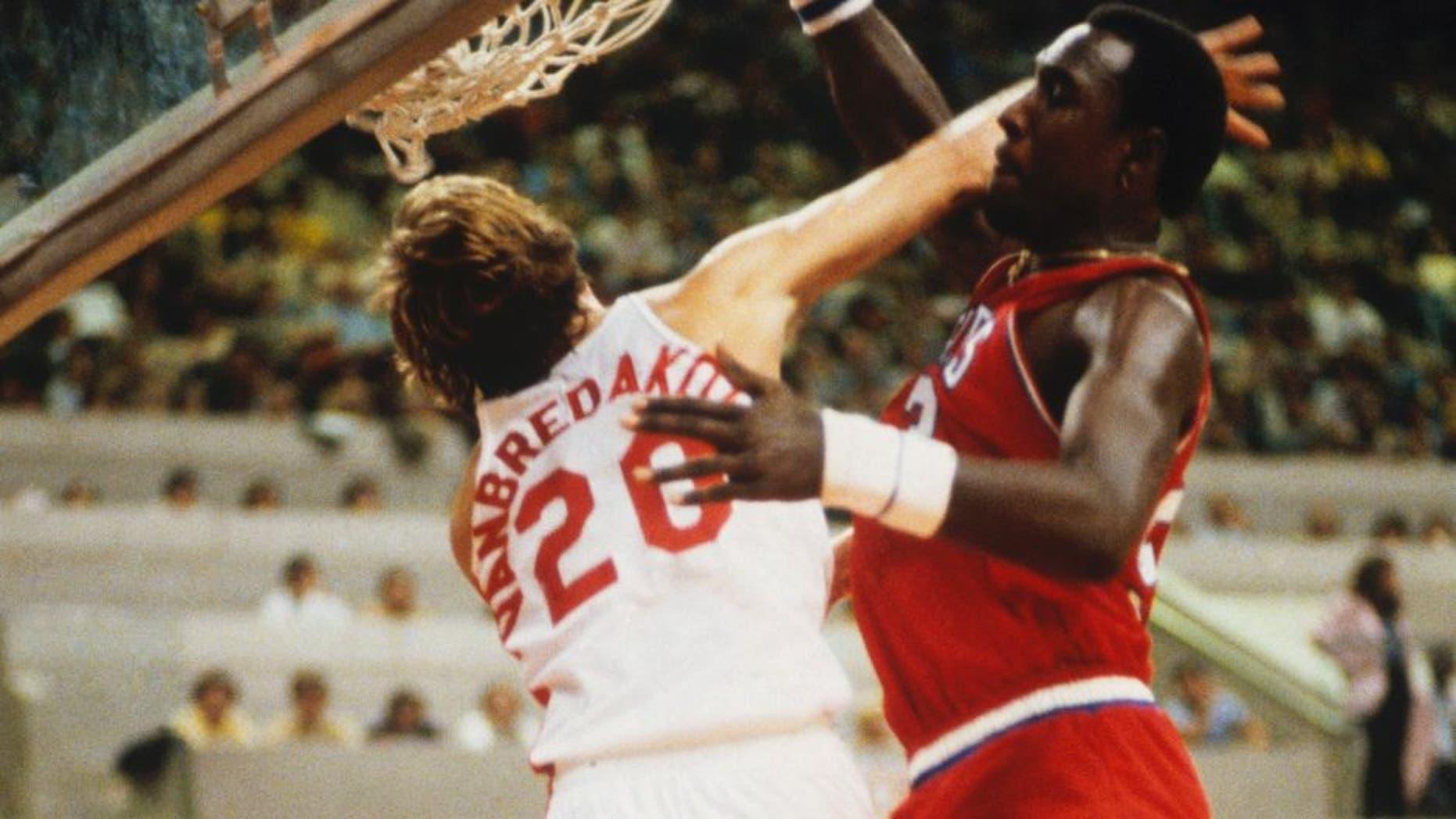 UNDATED: Philadelphia 76ers' center Darryl Dawkins #53 jumps to dunk against New York Nets' Jan Van Breda Koff #26. (Photo by Focus on Sport/Getty Images) *** Local Caption *** Darryl Dawkins;Jan Van Breda Koff