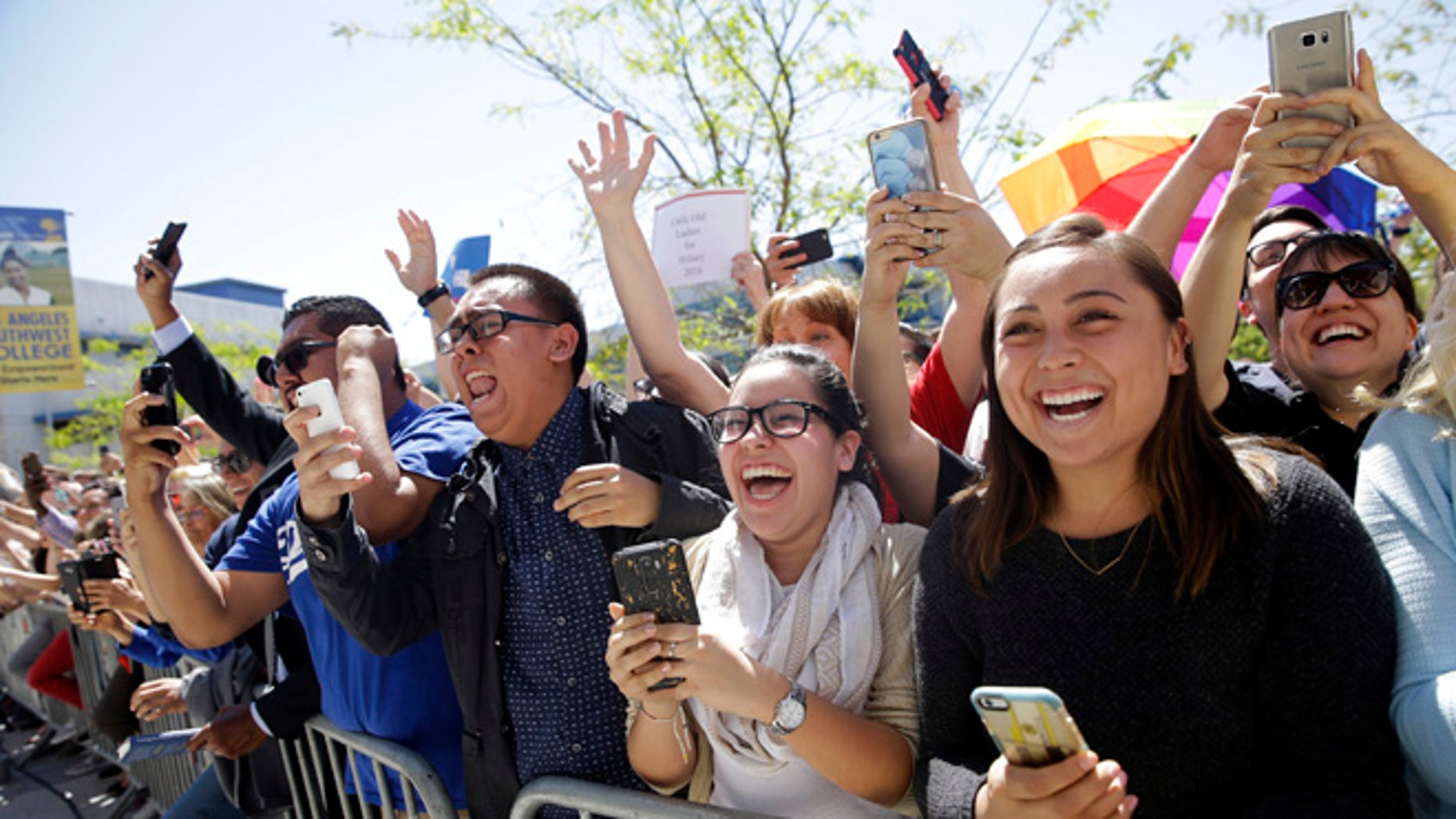 FILE - In this April 16, 2016 file photo, supporters in the overflow area cheer as Democratic presidential candidate Hillary Clinton walks toward them during a campaign event at Los Angeles Southwest College in Los Angeles. Facing a close contest in California with Bernie Sanders, Clinton returns to a crucial battleground this week when she will rally supporters in East Los Angeles, a heavily Hispanic neighborhood which she carried as a presidential candidate in 2008.  (AP Photo/Jae C. Hong, File)