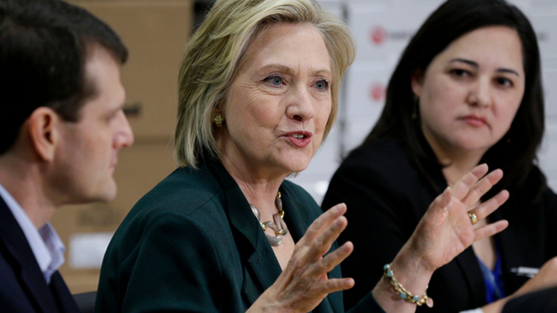 April 15, 2015: Democratic presidential candidate Hillary Rodham Clinton, center, speaks during a small business roundtable in Norwalk, Iowa. (AP Photo/Charlie Neibergall)