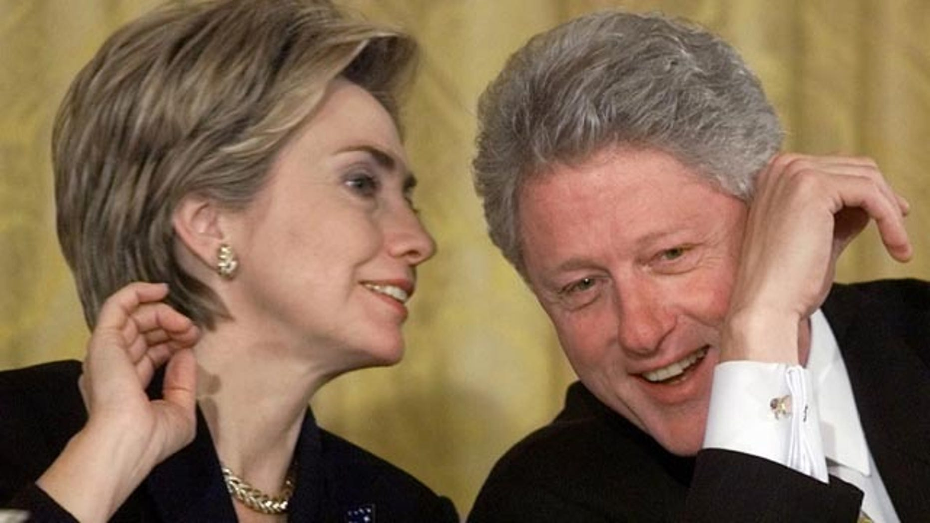 FILE - In this Oct. 22, 1999 file photo, President Bill Clinton and first lady Hillary Rodham Clinton talk during the White House Conference on Philanthropy in the East Room of the White House in Washington. As first lady in the final year of the Clinton administration, Hillary Rodham Clinton approved the unveiling of a White House plan to push for tax breaks for private foundations and wealthy charity donors at the same time that the William J. Clinton Foundation was soliciting donations for her husbands presidential library, recently-released Clinton-era documents show. (AP Photo/Khue Bui, File)
