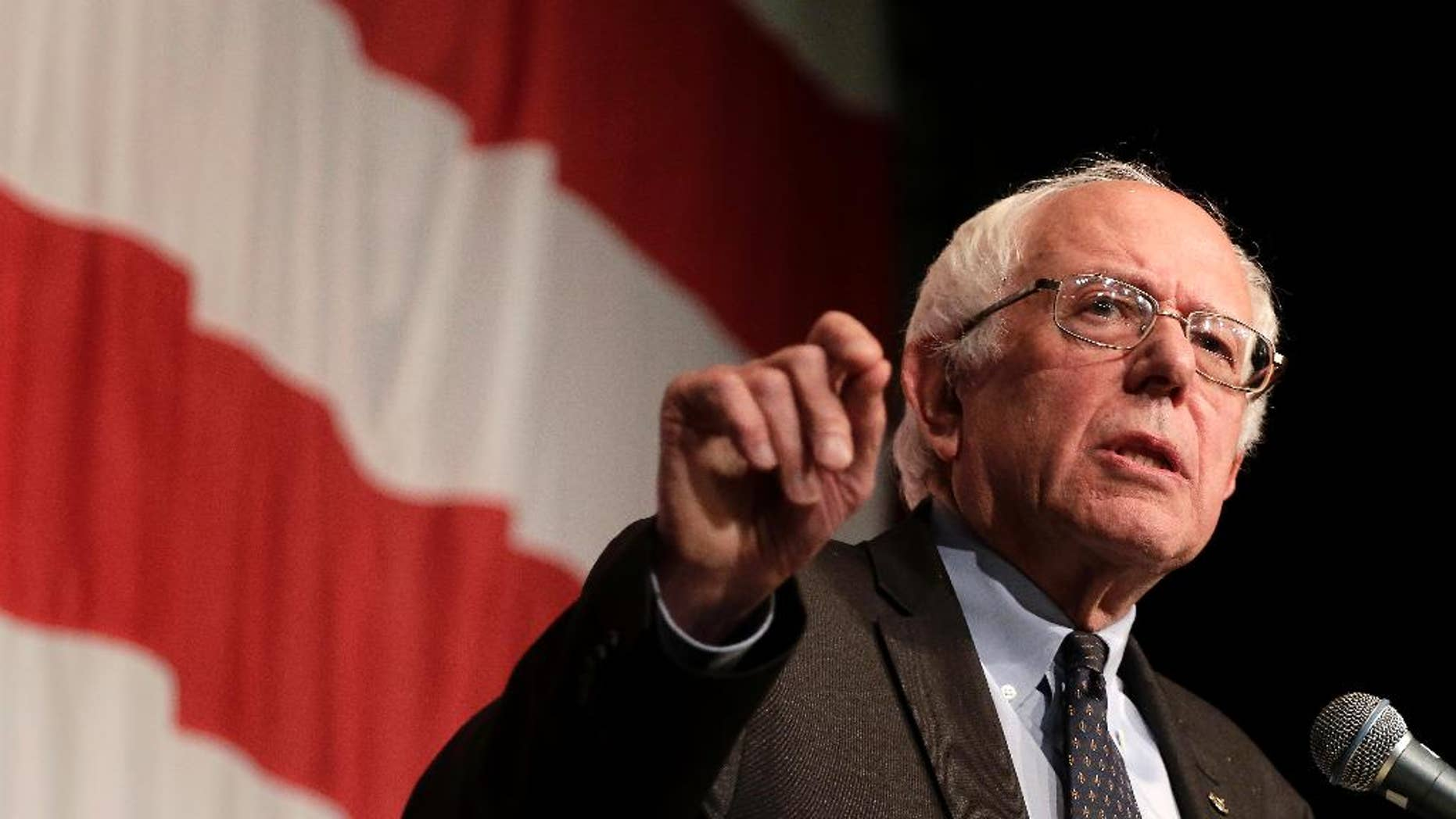 """FILE - In this Aug. 14, 2015, file photo, Democratic presidential candidate Sen. Bernie Sanders, I-Vt., speaks at the at the Iowa Democratic Wing Ding at the Surf Ballroom in Clear Lake, Iowa. The Vermont senator sought to broaden his appeal with black voters Friday, Aug. 21, 2015, in speeches in South Carolina denouncing """"institutional racism"""" in the American political and economic system. (AP Photo/Charlie Riedel, File)"""