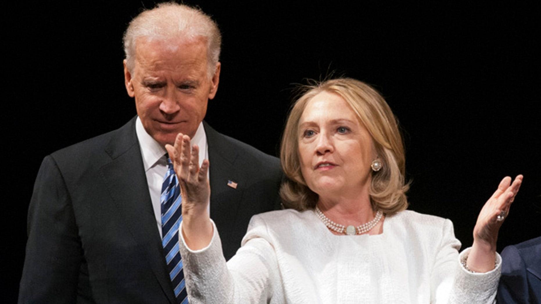 April 2, 2013: Vice President Joe Biden and former Secretary of State Hillary Rodham Clinton are seen in Washington.