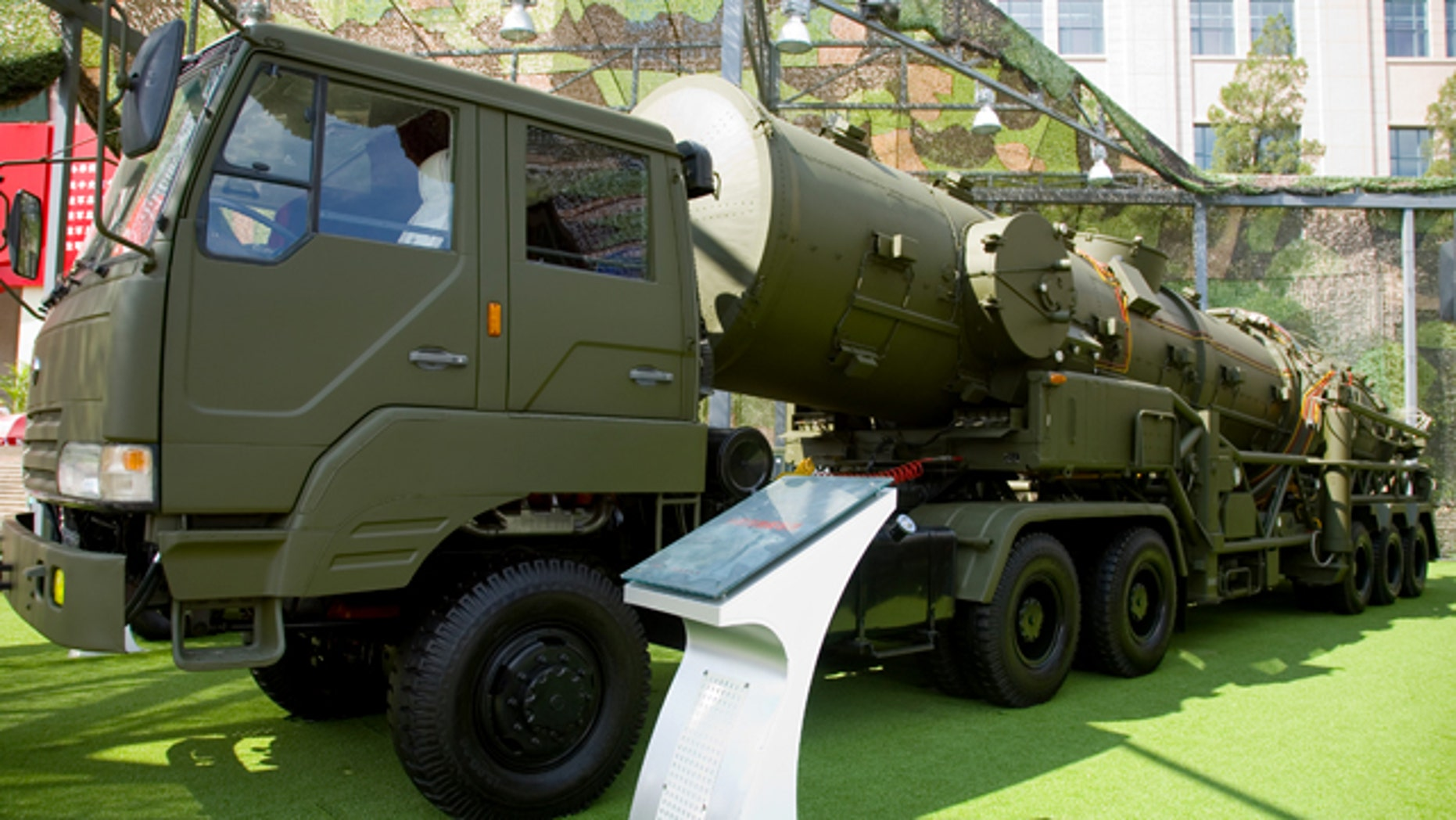 The Dong Feng 21A and launcher vehicle are displayed at the Beijing Military Museum. China is reportedly working on developing the world's first antiship ballistic missile based on a similar design.