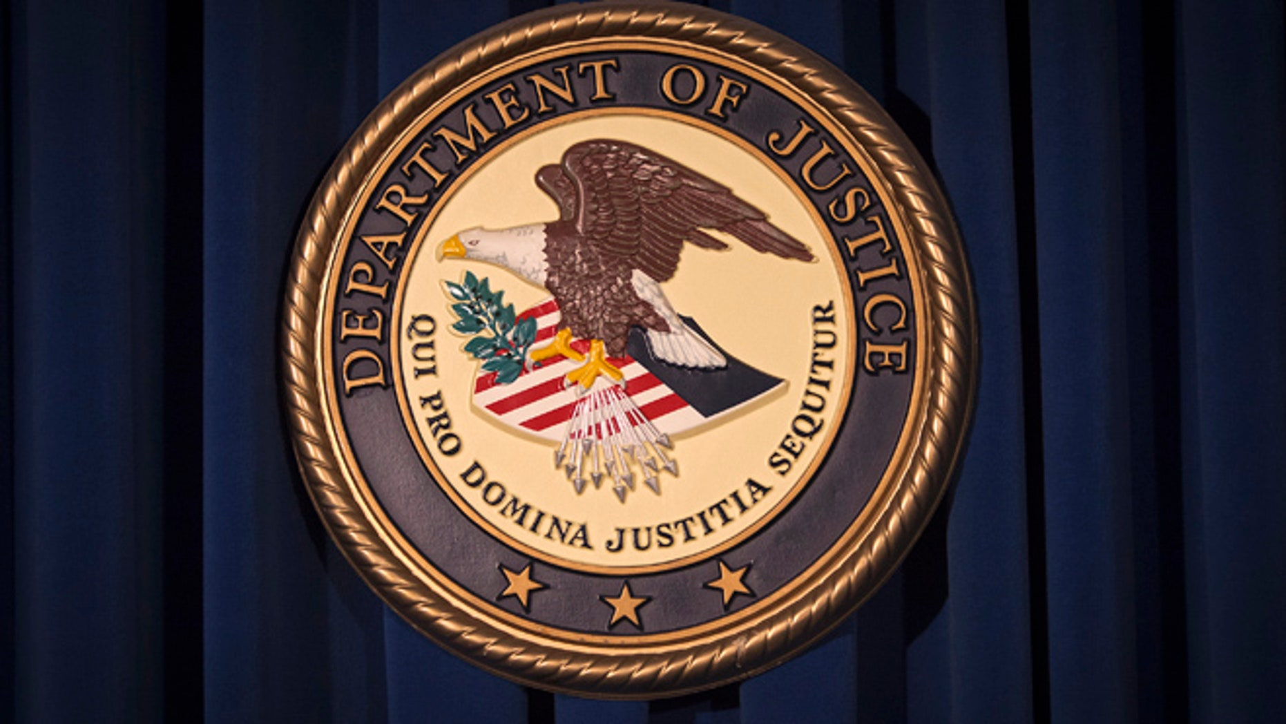 The Department of Justice (DOJ) logo is pictured.