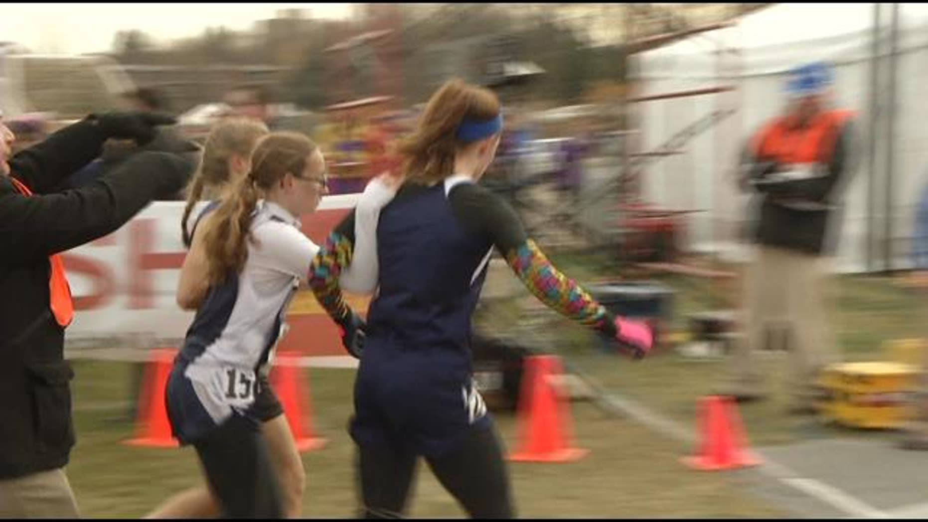 Senior Kailee Kiminski, of Esko, and junior Tierney Winter, of Janesville, forfeited the race last weekend after assisting Jackson County Central freshman Jessica Christoffer cross the finish line. (Courtesy: KEYC-TV)