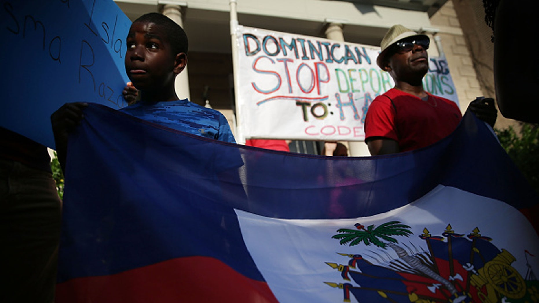 Rally outside the Embassy of the Dominican Republic in Washington, DC, protesting the mass deportations of Haitians.