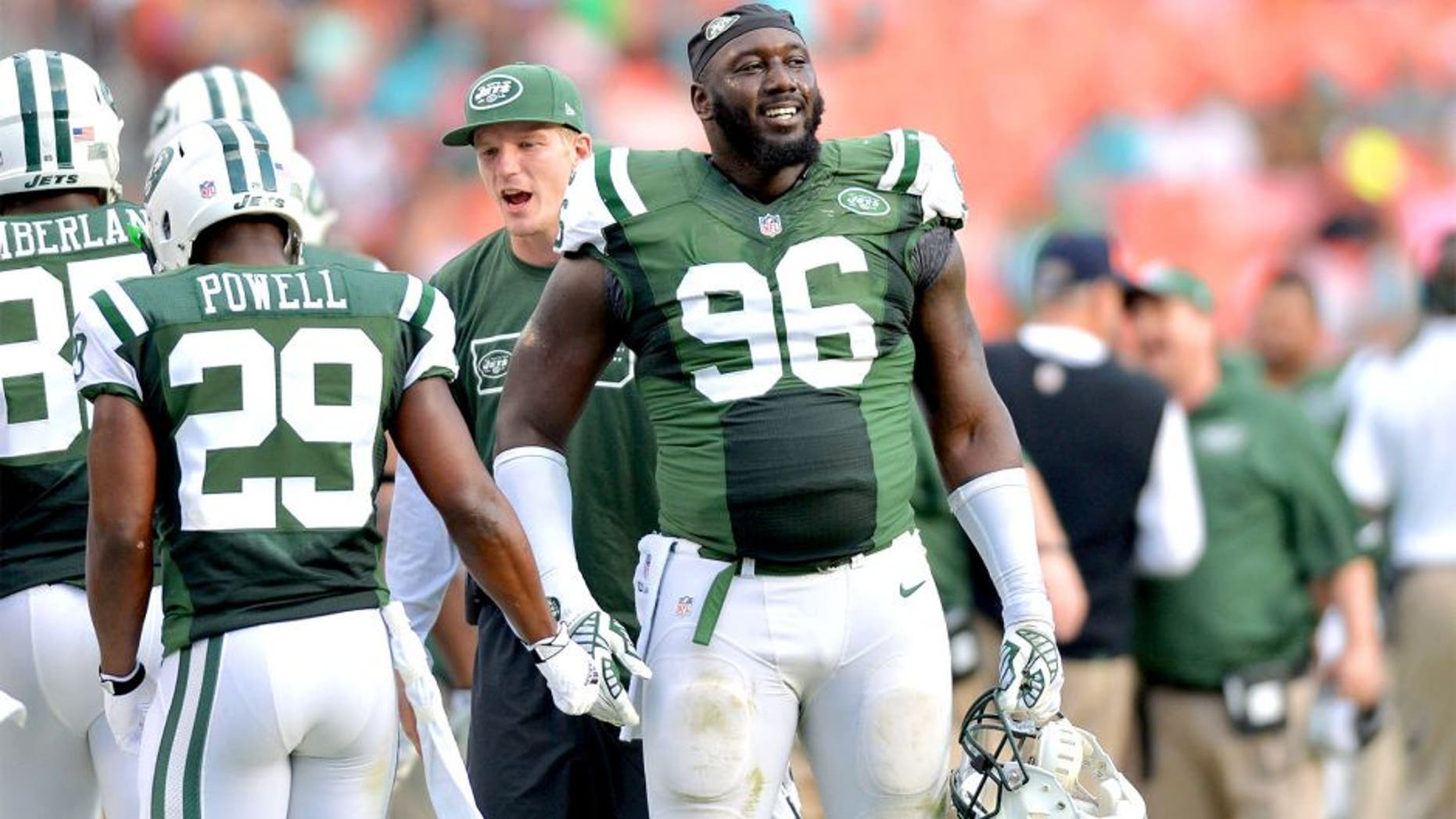 Dec 28, 2014; Miami Gardens, FL, USA; New York Jets defensive end Muhammad Wilkerson (96) laughs on the sideline during the second half against the Miami Dolphins at Sun Life Stadium. Mandatory Credit: Steve Mitchell-USA TODAY Sports