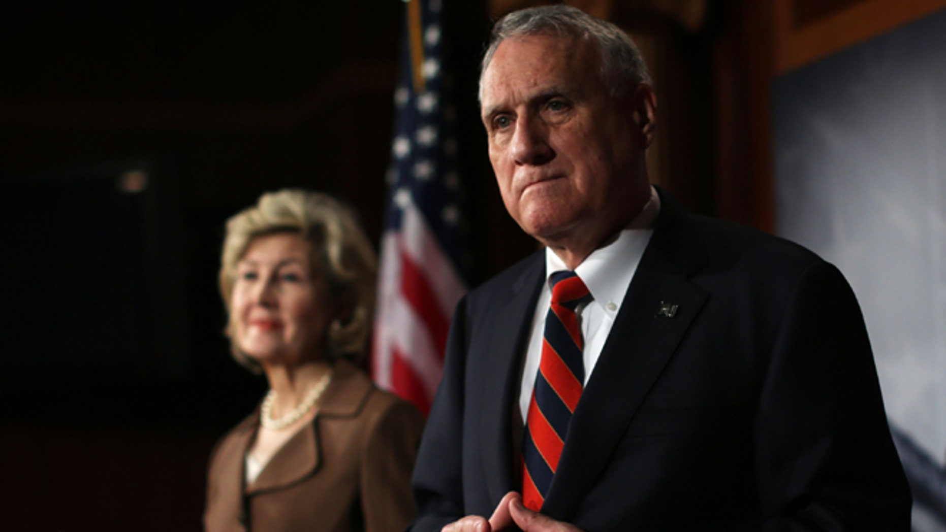WASHINGTON, DC - NOVEMBER 27:  U.S Senator Kay Bailey Hutchison (R-TX) (L) and Senator Jon Kyl (R-AZ) (R) listen during a news conference November 27, 2012 on Capitol Hill in Washington, DC. Senator Hutchison and Kyl held a news conference to discuss immigration reform.  (Photo by Alex Wong/Getty Images)