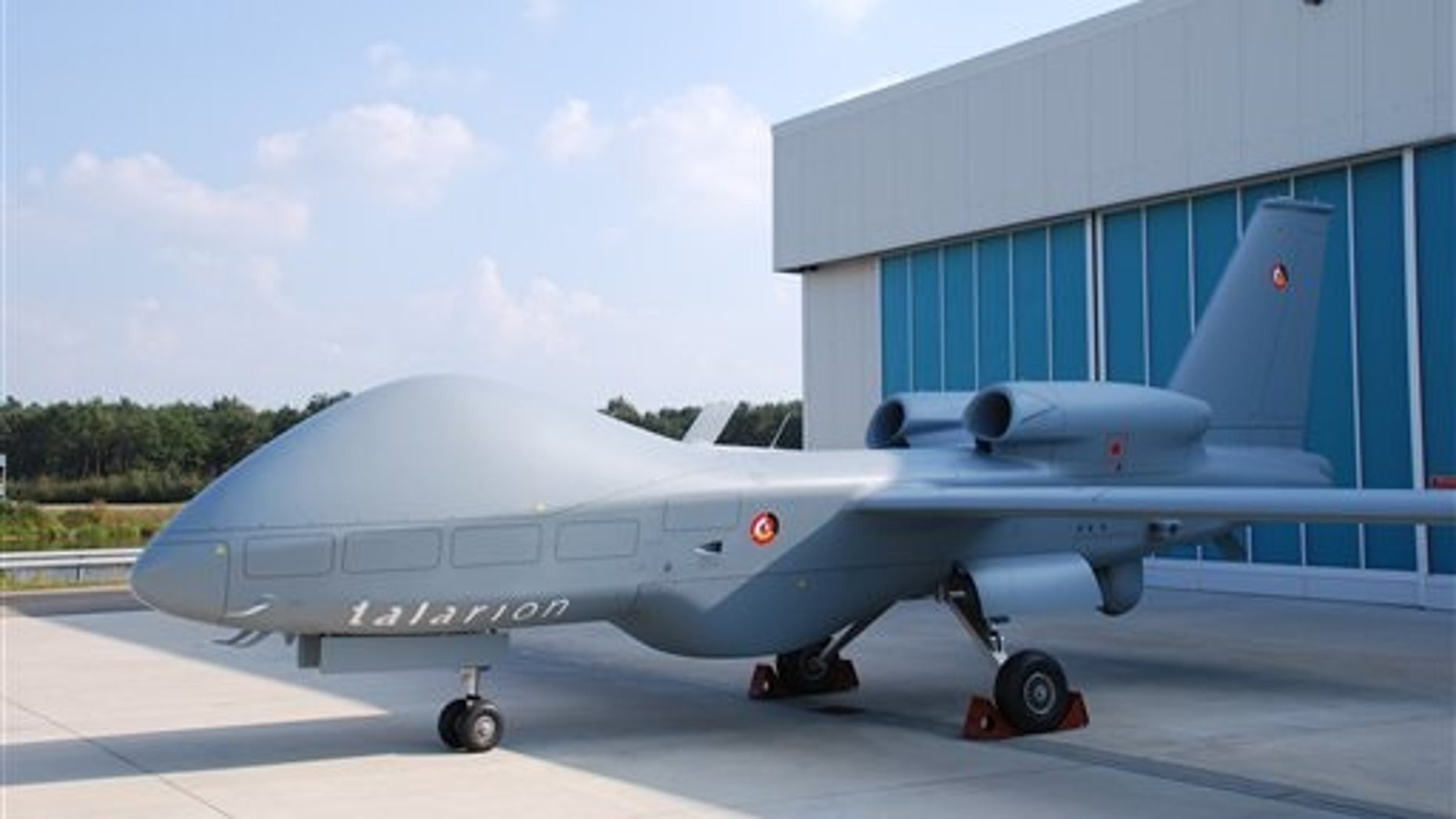 HANDOUT - An undated picture made available by eads on 18 May 2015 shows a Talarion drone manufactured by armaments manufacturer eads in front of a hangar. Photo by: picture-alliance/dpa/AP Images