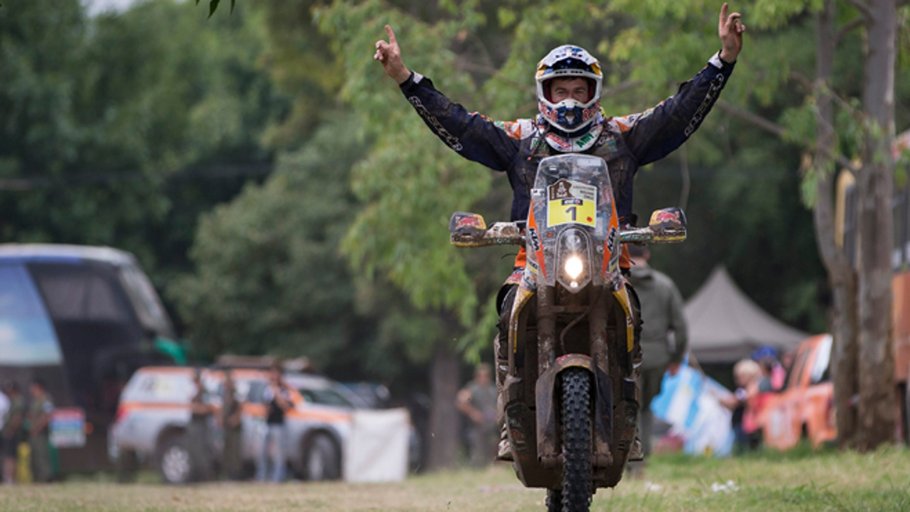 KTM rider Marc Coma of Spain celebrates after winning the Dakar Rally 2015 motorcycle category, at the end of twelfth stage in Buenos Aires, Argentina, Saturday, Jan. 17, 2015. (AP Photo/Felipe Dana)