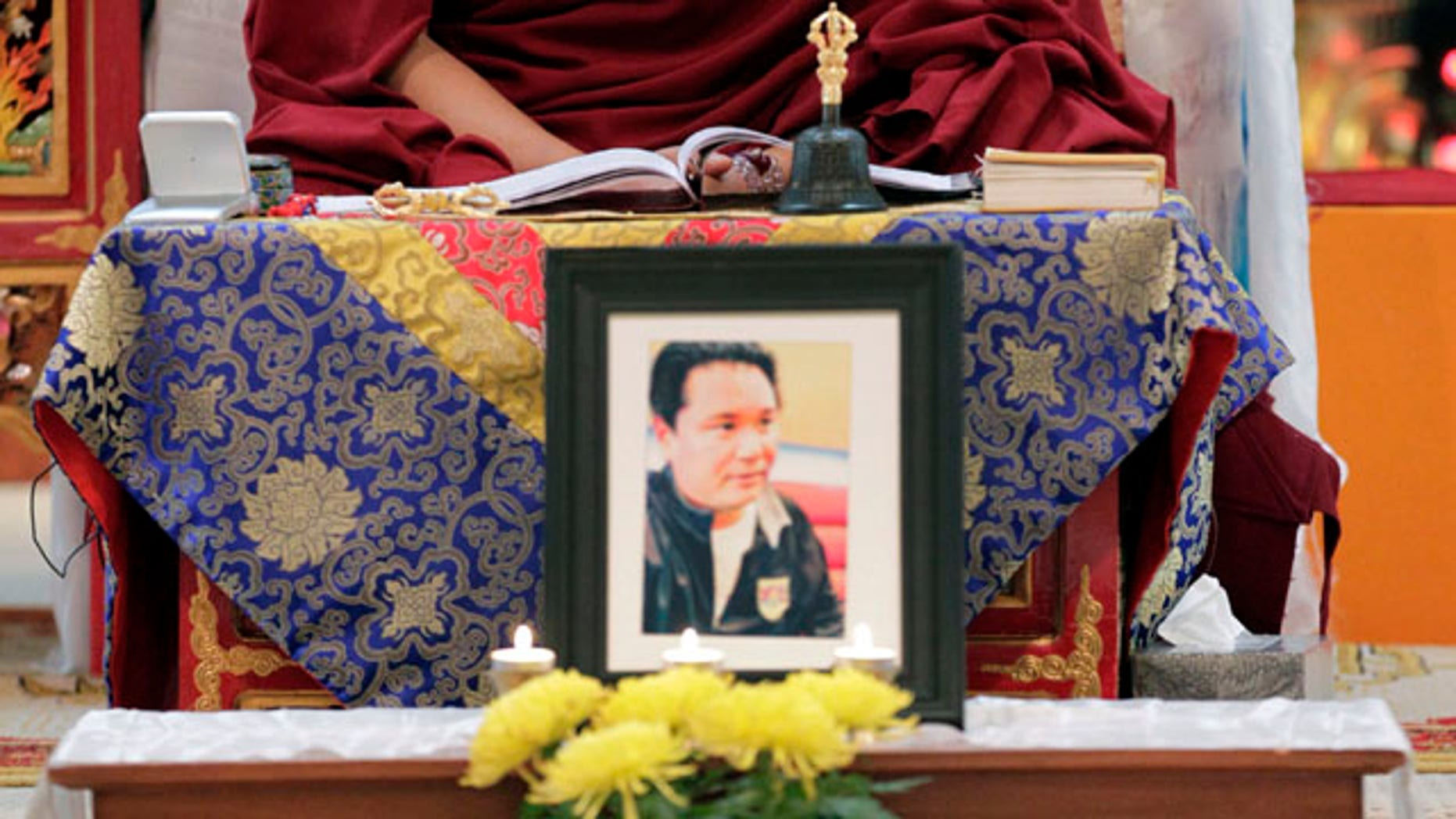Feb. 15: The Venerable Arjia Rinpoche, director of The Tibetan Mongolian Buddhist Cultural Center, says a prayer behind a photograph of Jigme Norbu, the Dalai Lama's nephew, in Bloomington, Ind. Norbu was struck and killed by an SUV along a Florida coastal highway while on a walk to promote Tibetan independence from China.