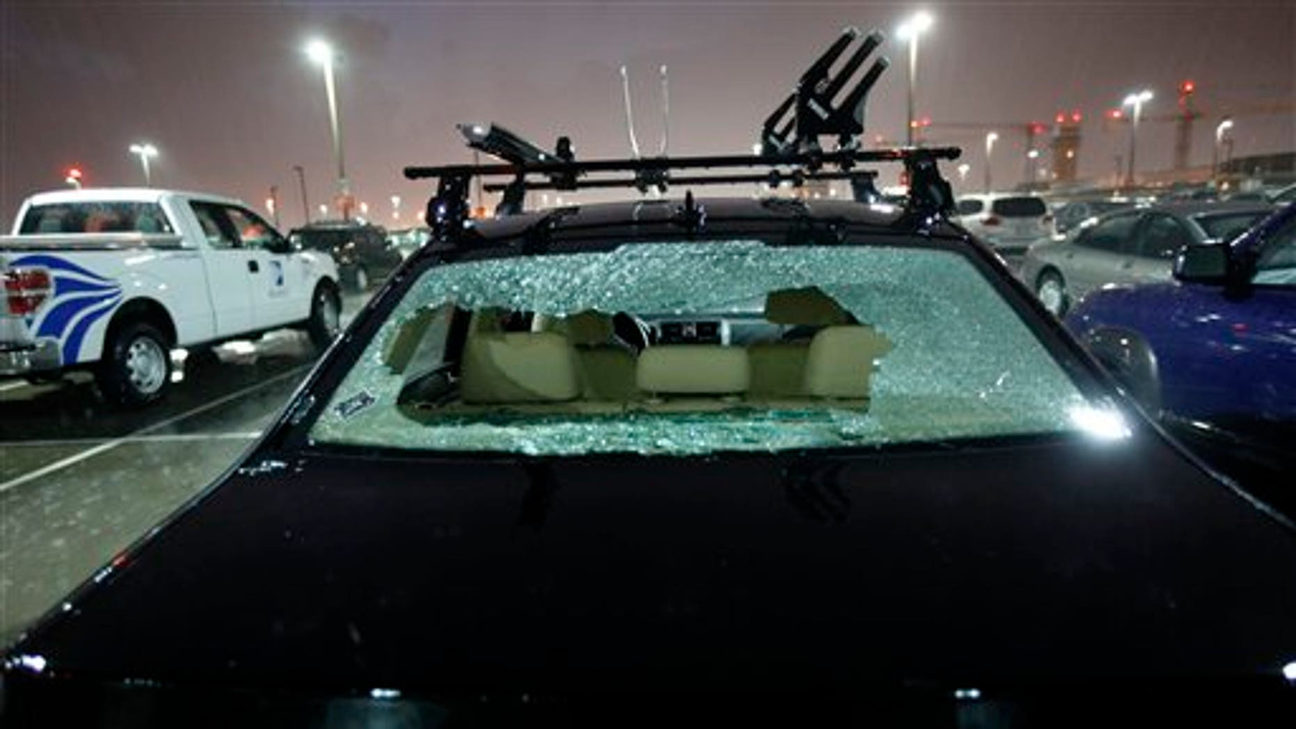May 24: The rear windshield of a parked car at Love Field Airport in Dallas was shattered by hail during severe weather that also produced a tornado nearby.
