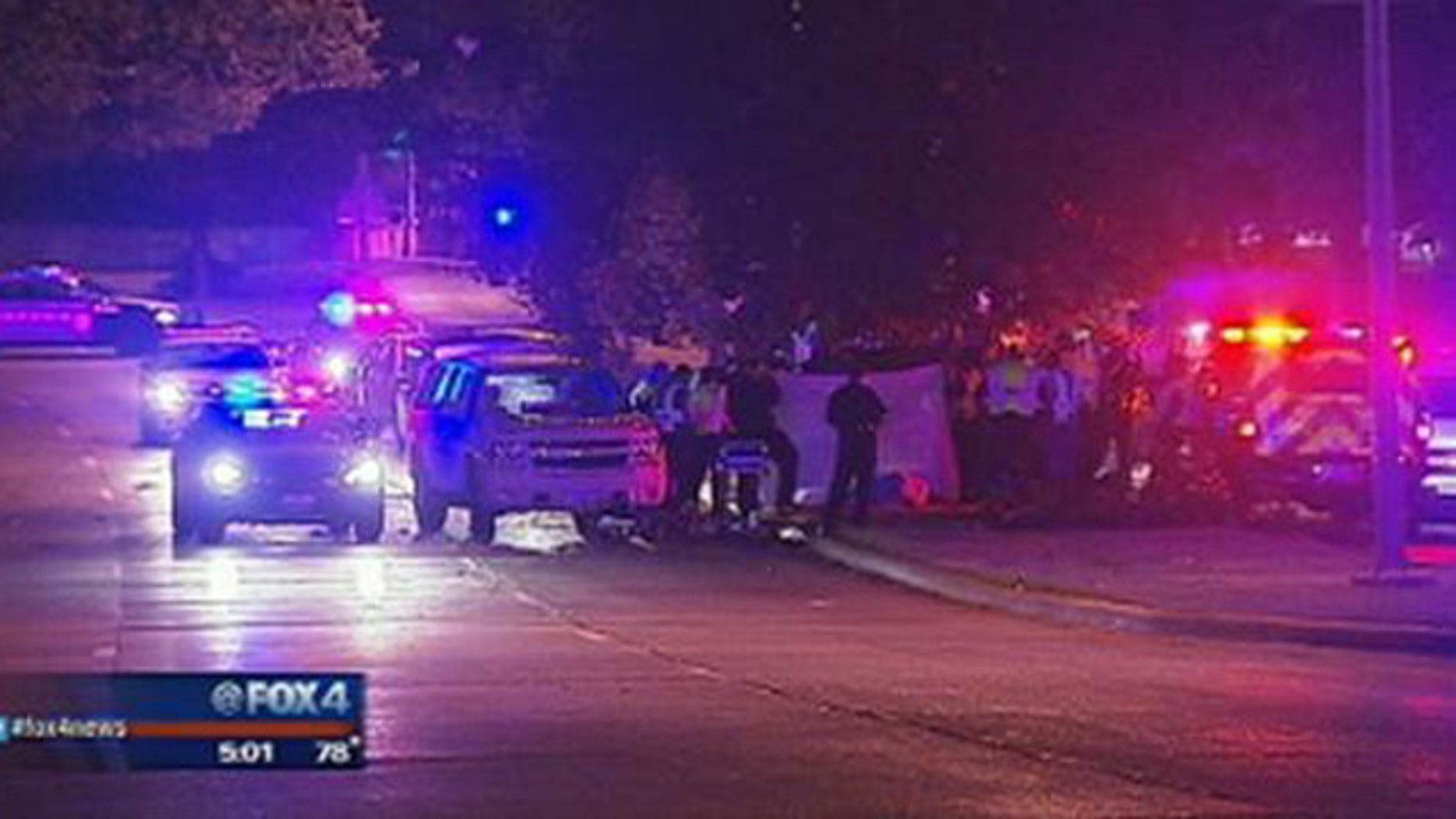 August 31, 2014: Police gather at the site of a car crash that killed six people, including three teenagers, in the Oak Cliff section of Dallas, Texas. (MyFoxDFW.com)