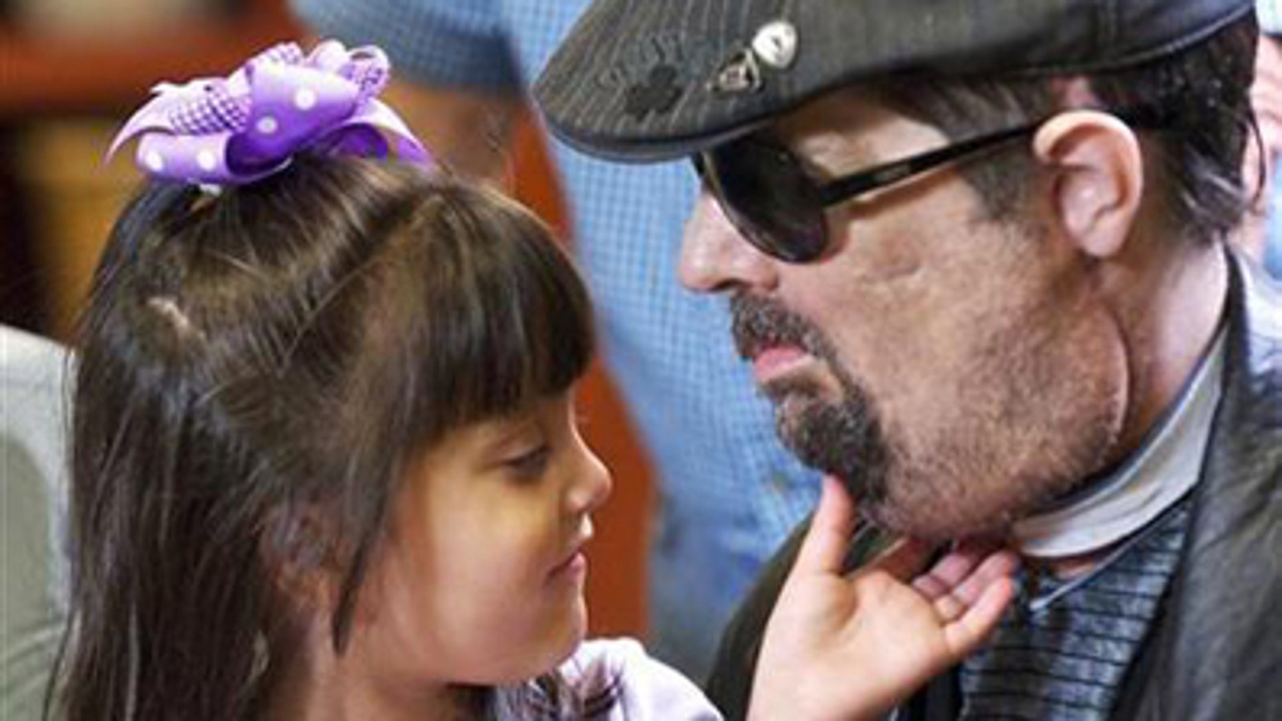 Full face transplant patient Dallas Wiens is seen with his 4-year old daughter Scarlette in this undated handout image.